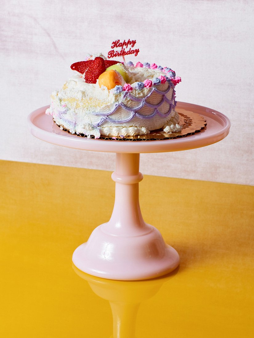 I couldn't find a good picture from Proof, but the photography on  Coming Soon's  website is amazing. You'll want to buy everything, too. (image of  Mosser Glass Pink Milk Glass Cake Stand via  comingsoonnewyork )