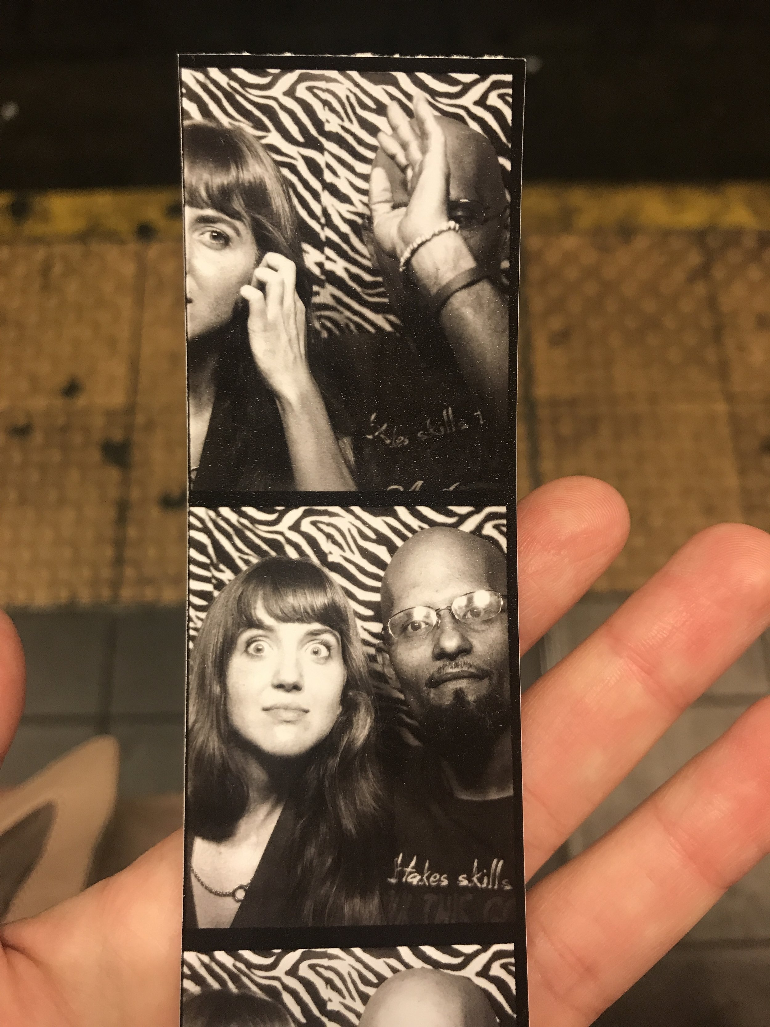Getting into a photobooth with a stranger because you need a better note to end the day.