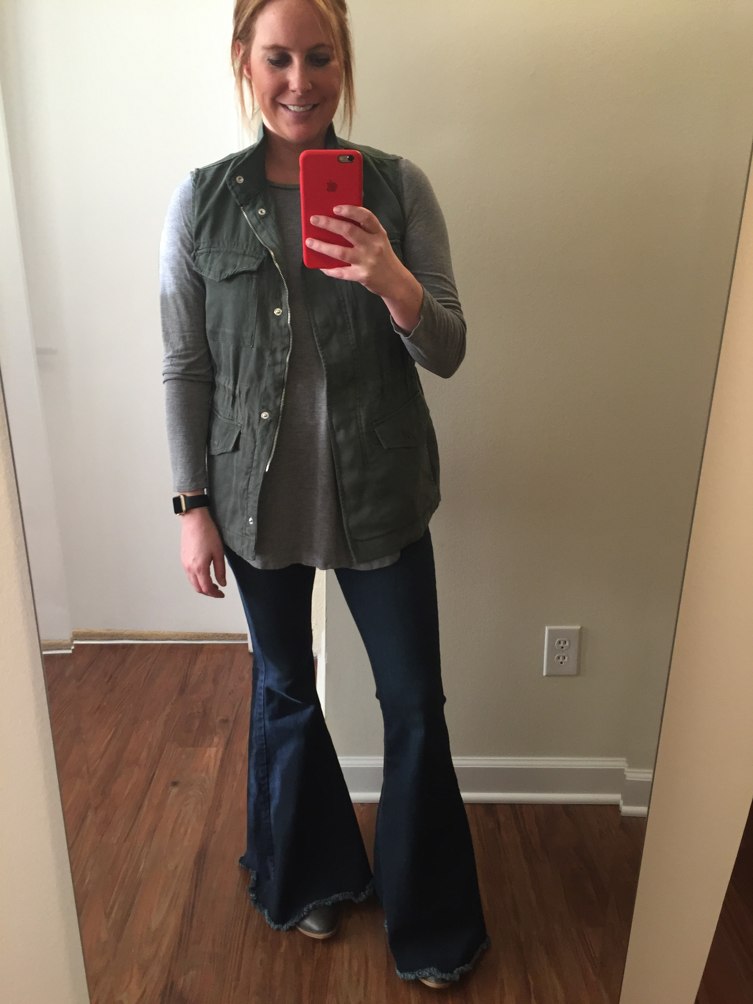 Vest: Gap,  Tencel®utility vest , Tee: Old Navy,  Long & Lean Ribbed Tunic , Jeans: Free People,  Denim Super Flare , Watch: Apple,  38mm Gold Aluminum Case  (with Black Sport Band)