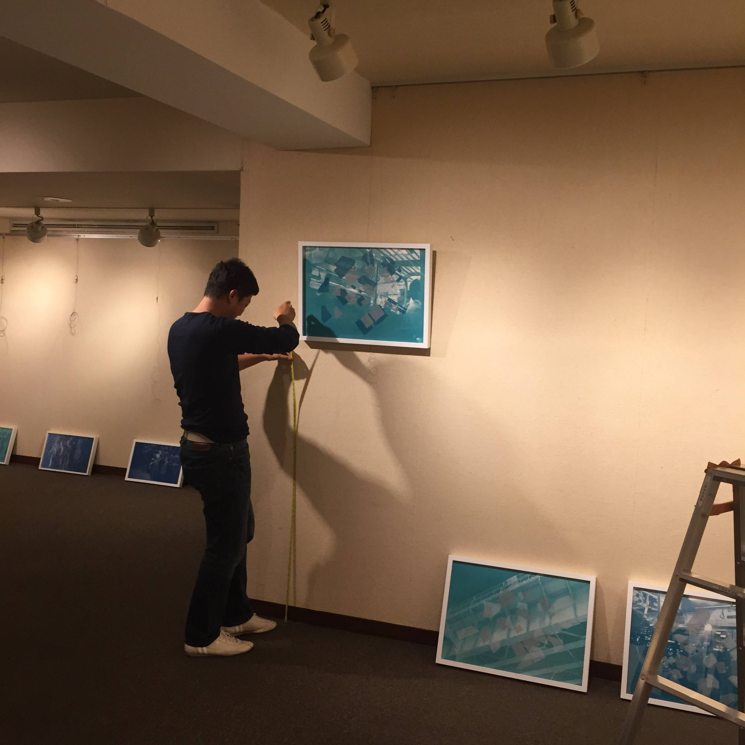 Hanging the show, my good friend put up my works!