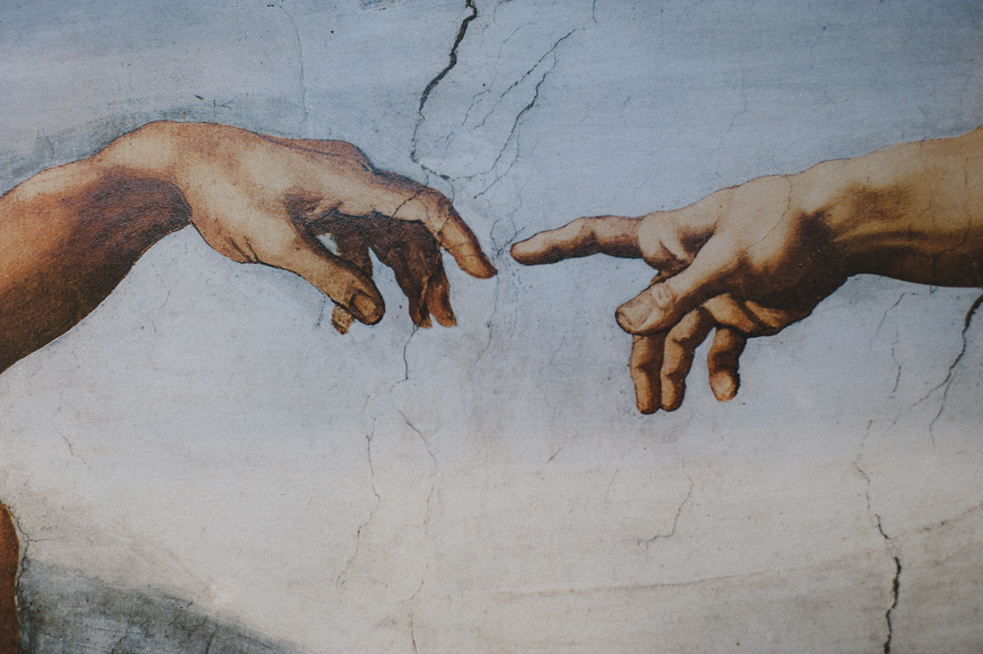 Man's hand on left, God's on right.  I love the symbolism of God deliberately and wholeheartedly reaching for us while we often idly and leisurely reach for Him.  Lots of deep thoughts on this one.