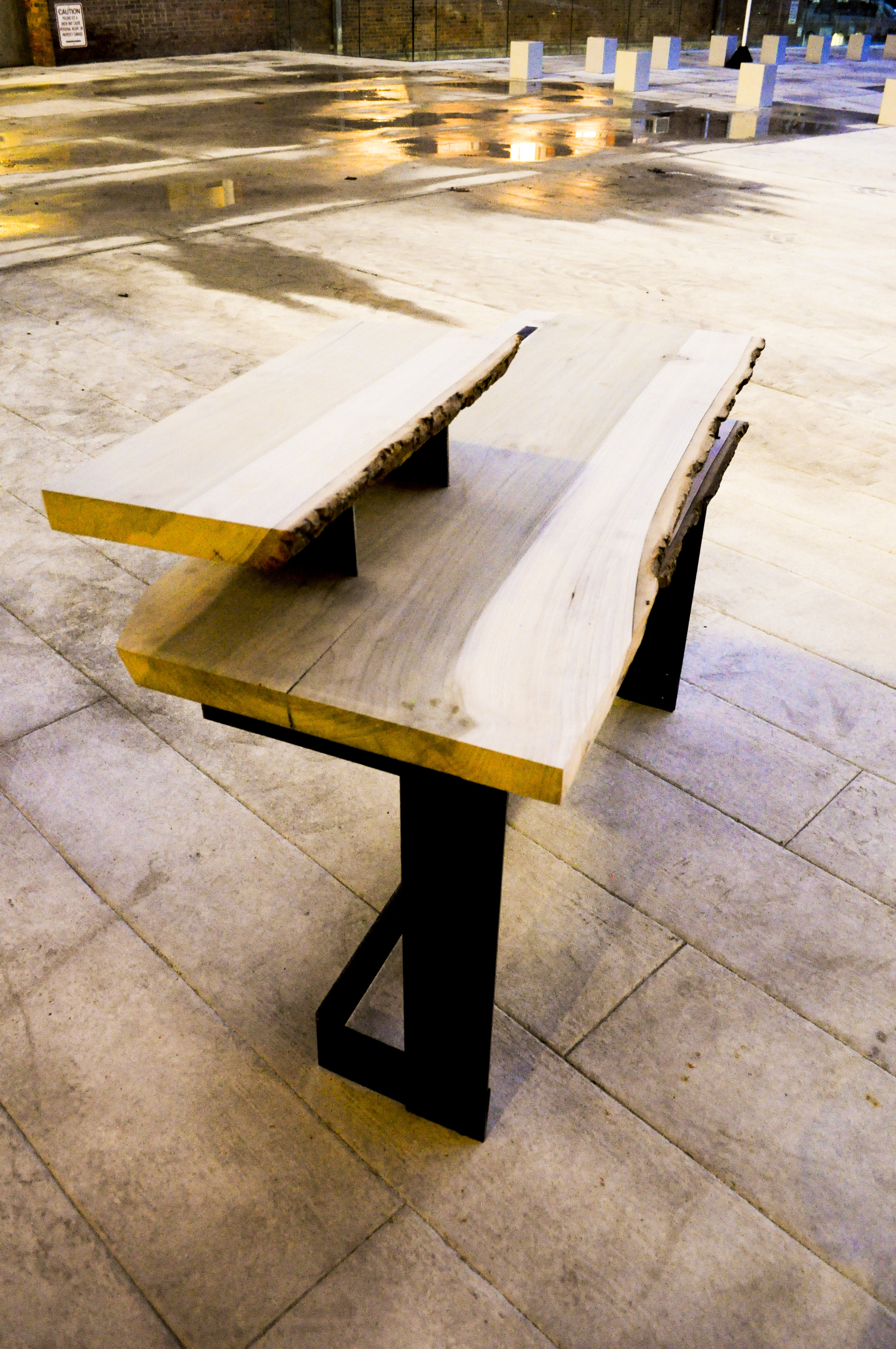 A surface for ideas - Natural-edged poplar combined with a steel base.Constructed by folding the metal through the wood, suspending the slab in the air and making a space for one to sit, ponder and manifest ideas into life.Approx. size: 50