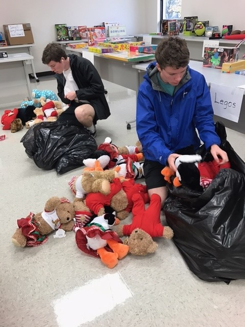LTHS students Peter and Chris Stockton sorting toys at the EDC.