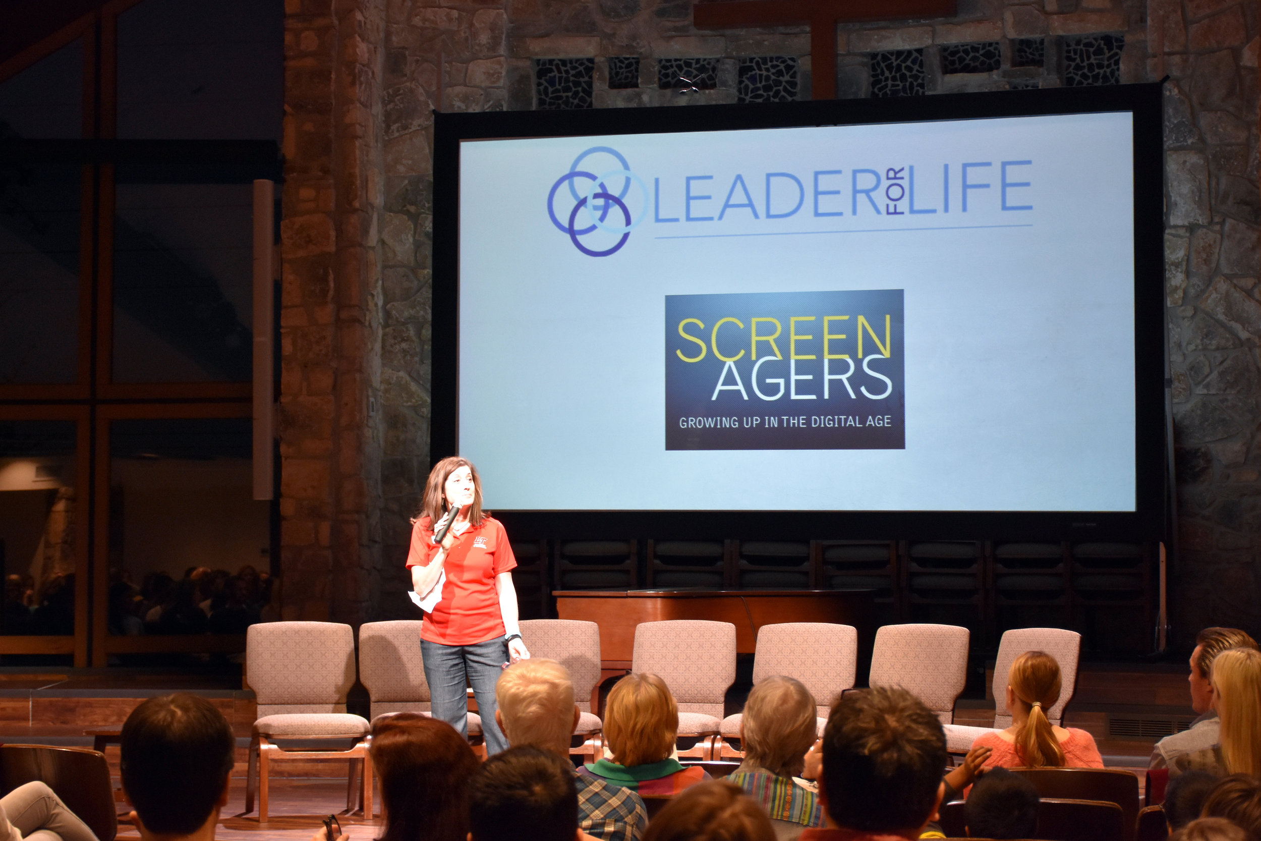 Kathleen Hassenfratz, LTISD Health and Social Programs Coordinator, welcomes attendees to the special showing of 'Screenagers.'