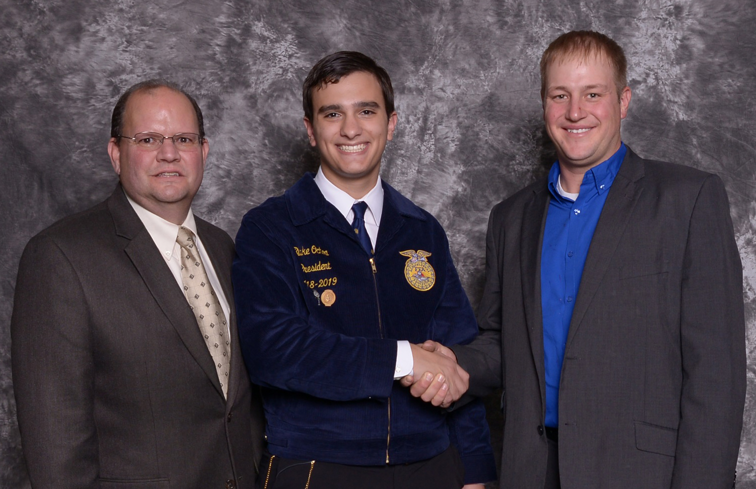 Pictured (left to right):  Kelly White , Lake Travis FFA advisor;  Blake Ochoa,  Lake Travis High School FFA chapter president; and  Russ Kohler , chair of the American Farm Bureau Federation's Young Farmers & Ranchers program.