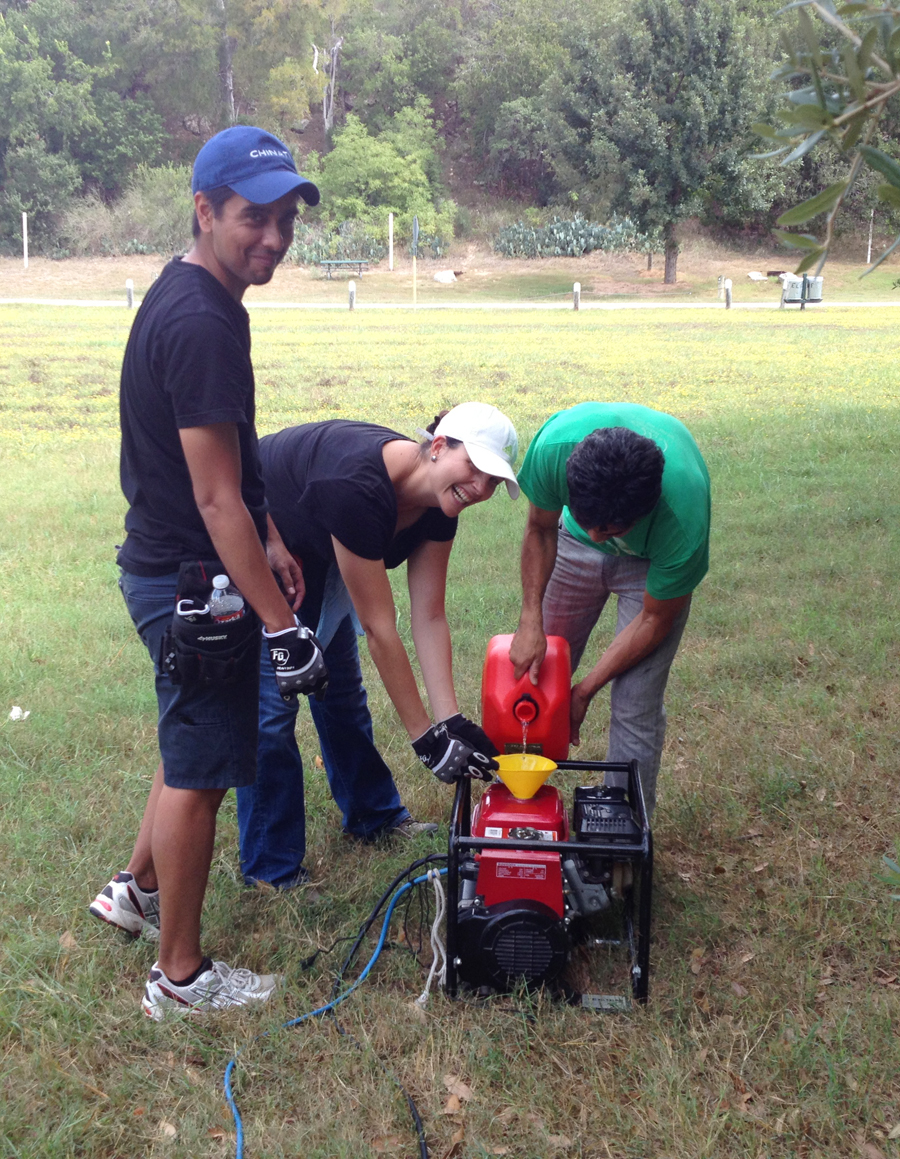And . . . how many assistants does it take to fill a generator with gasoline?