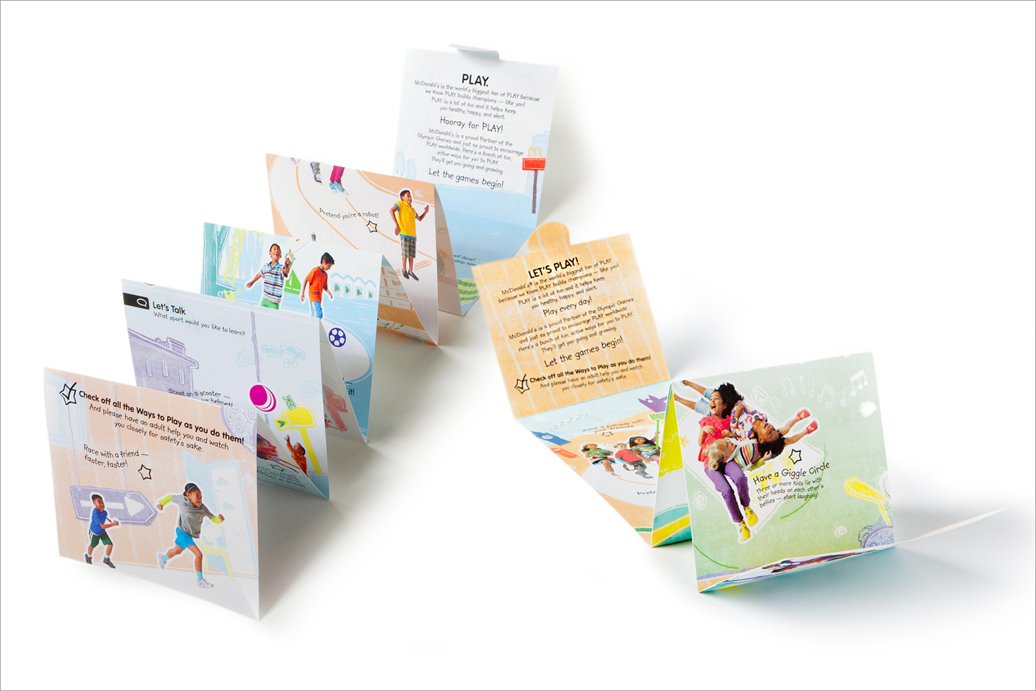 "Accordion-fold ""Champions of Play"" booklet included in Happy Meals worldwide."