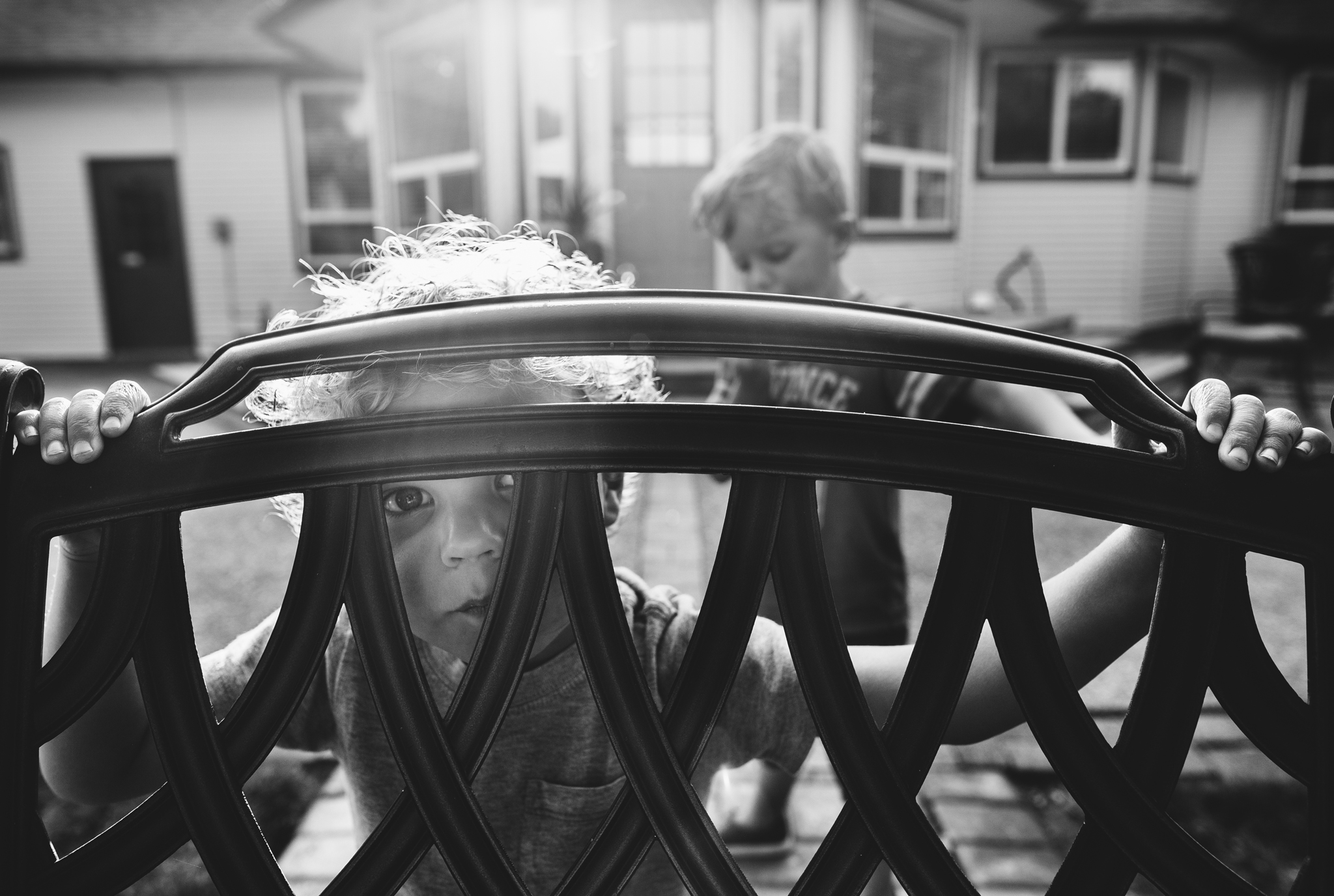 Sullivan looking through chair outside-1.jpg
