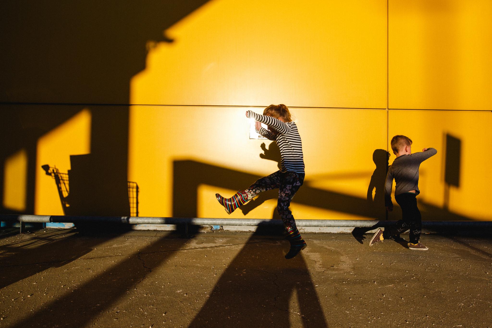 Bennet and Atti Ikea yellow wall-1.jpg