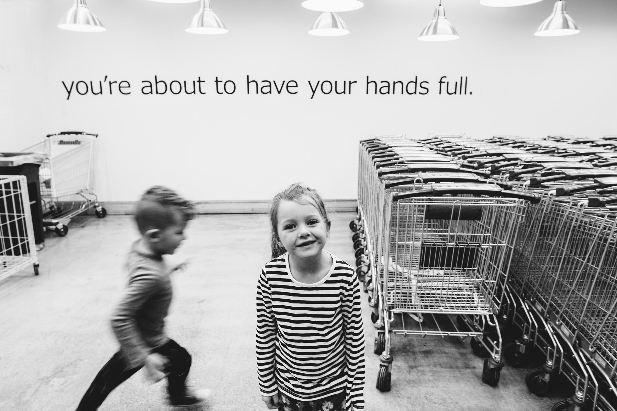 Bennett and Atticus ikea shopping cart hands full-1.jpg