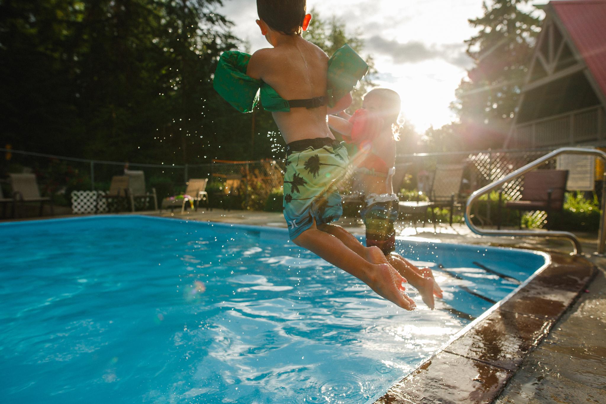 the boys calgary jumping in pool-1.jpg