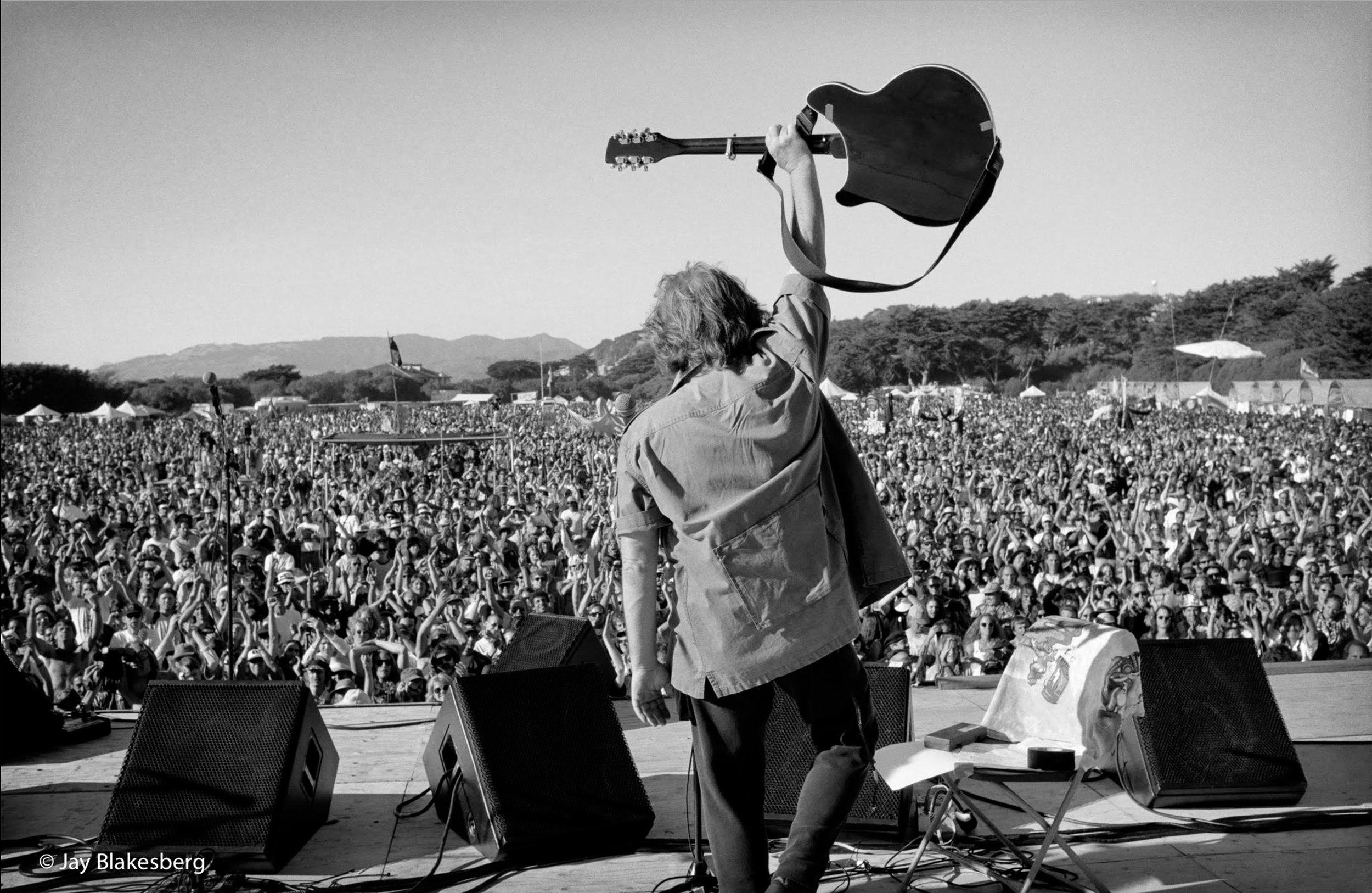 raising-guitar-by-JAY-BLAKESBERG.jpg