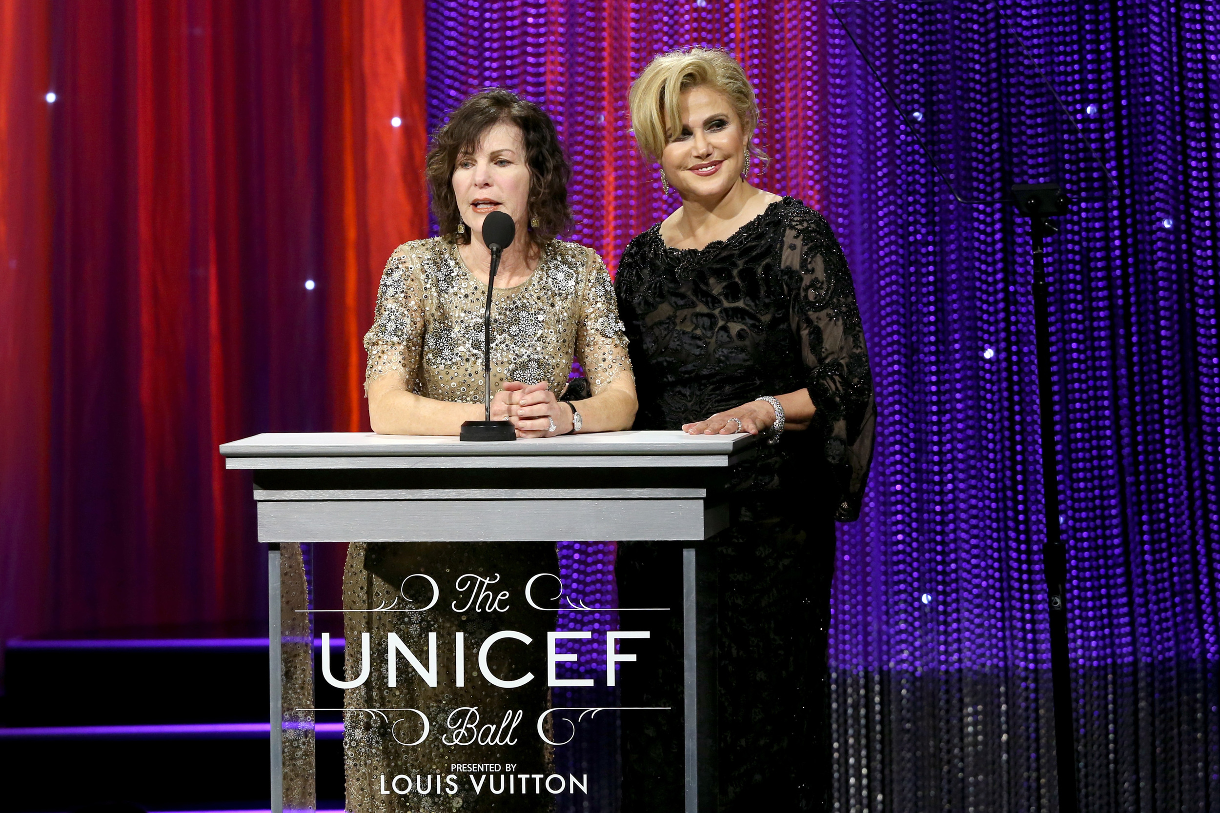 Chairs Lori Milken and Ghada Irani on stage at the 2016 UNICEF Ball