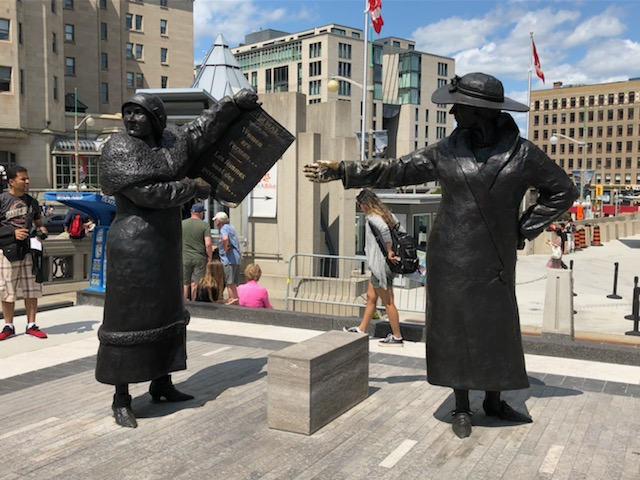 """Irene Parlby and Nellie McClung holding the """"We are Persons"""" newspaper headline - Ottawa"""