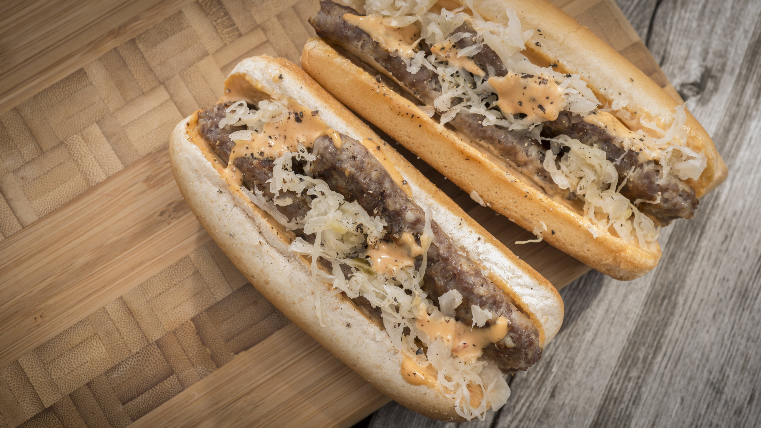 7. Reuben Brats - We love a good Reuben, but they can get a little messy -- whether it's in the lot or on the couch. Get the traditional Reuben flavor in a portable, tailgate-friendly way by adding Swiss cheese, sauerkraut, and Thousand Island dressing to your favorite Johnsonville brat.