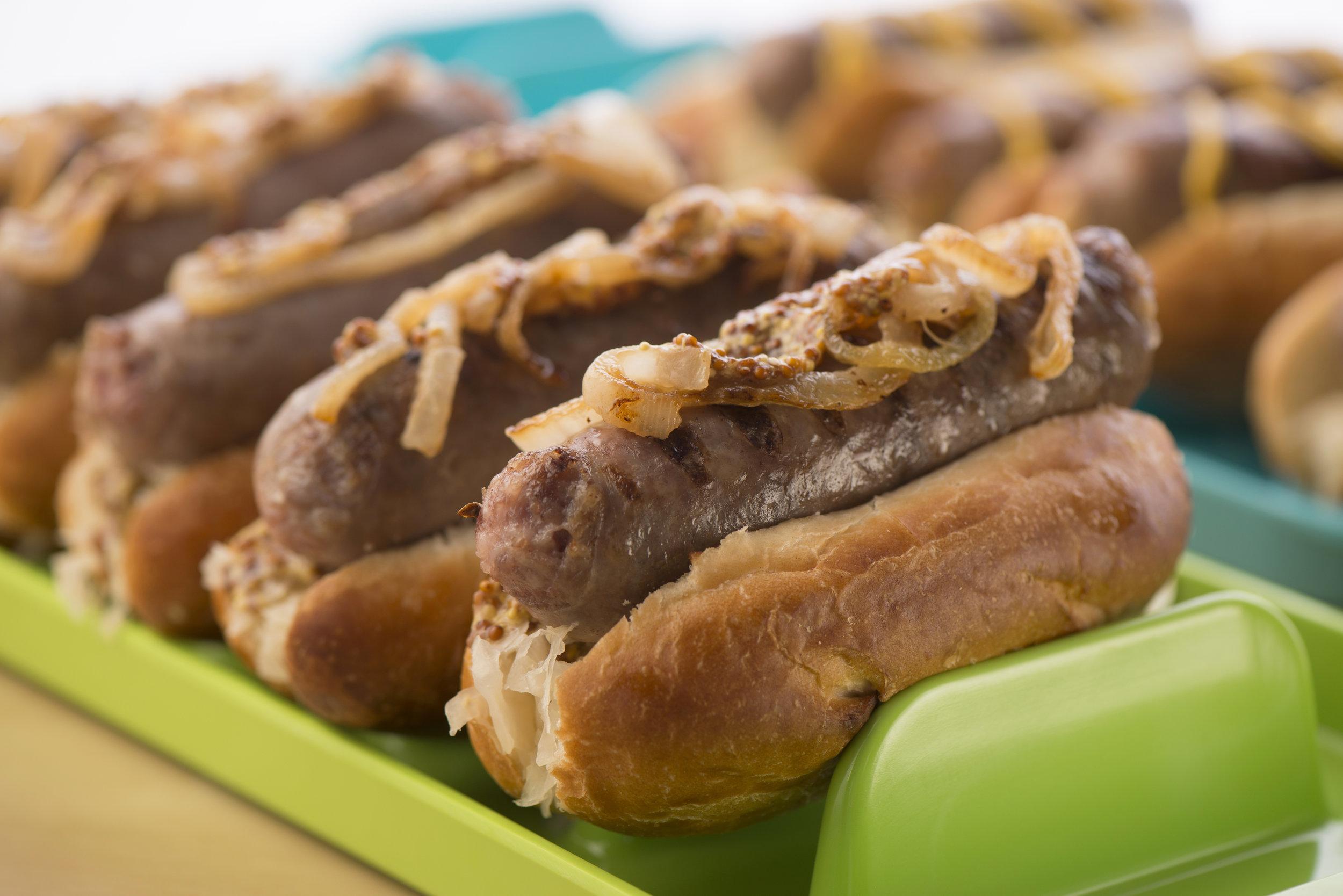 4. Apple Dijon Sauerkraut Brats - Tradition says that pork and sauerkraut bring good luck, so load your brat with some sauerkraut to send some luck to your favorite team!
