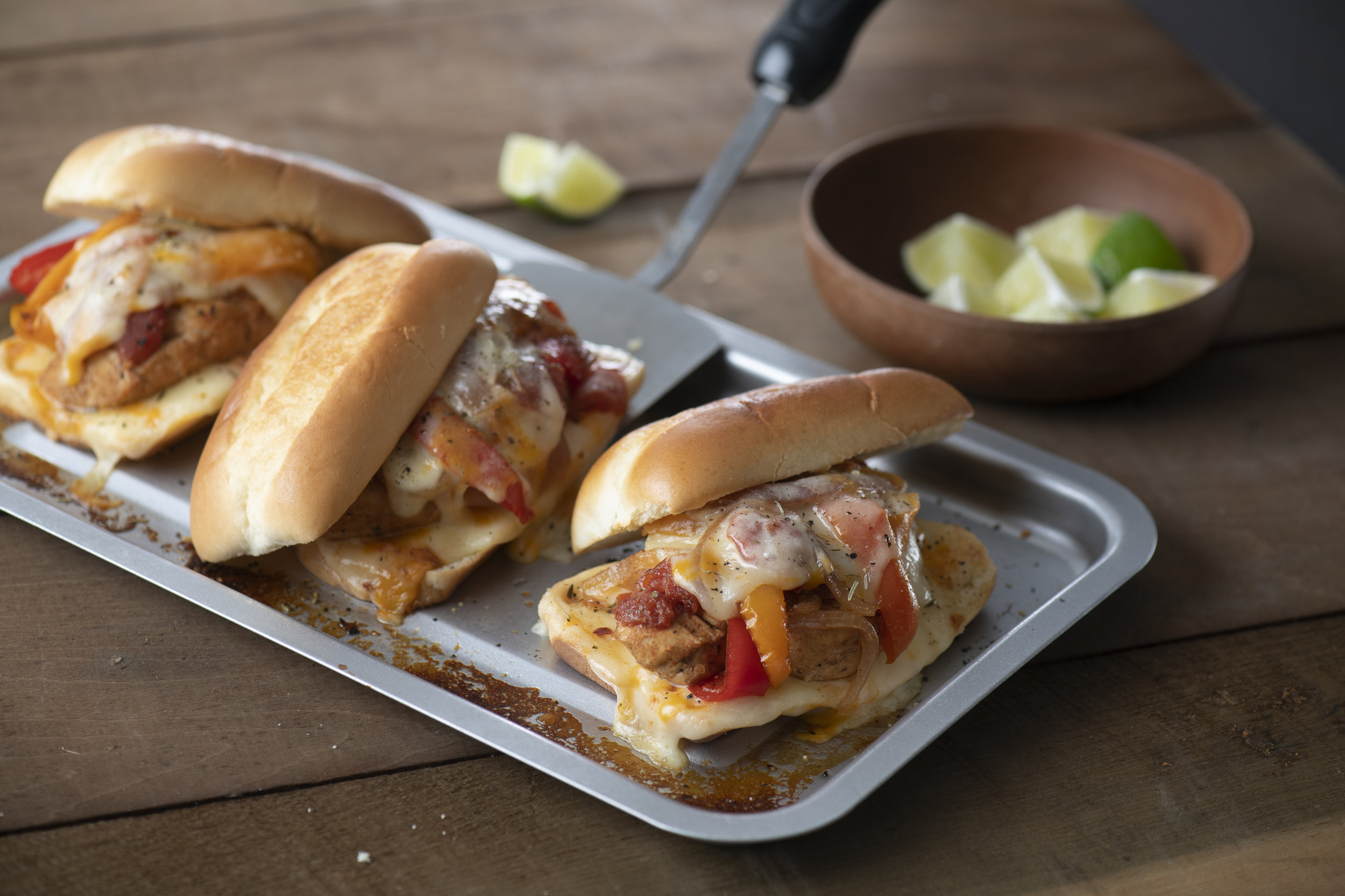 1. Chicken Fajita Sandwiches - Being the MVP of your tailgate spread is easy with these mouth-watering Chicken Fajita Sandwiches. Just layer chopped veggies and chicken in a slow cooker, cook on low while you prep the rest of your spread, and add the mix to one of our Deli Sub buns.