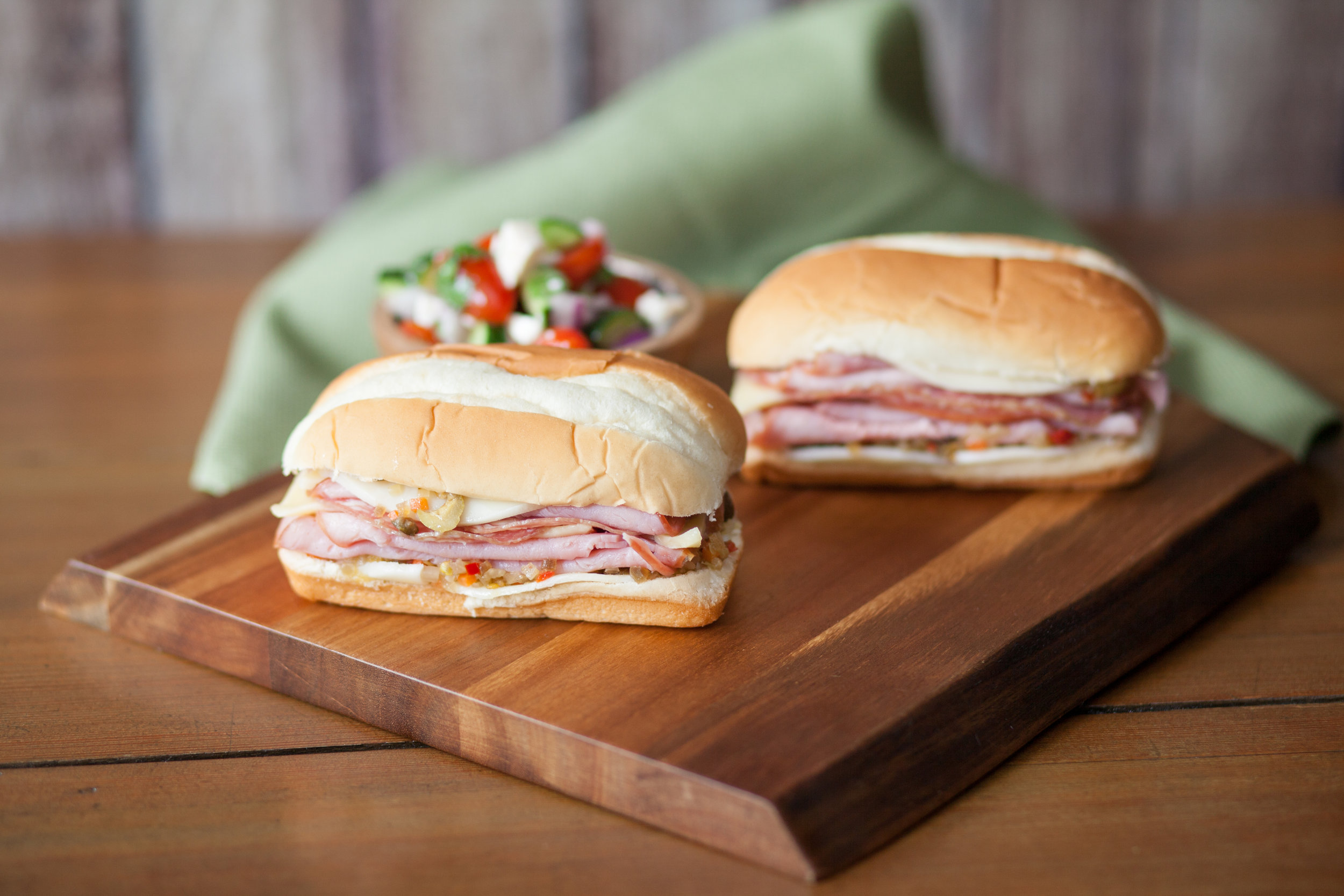 """1. Muffuletta Sandwich - This would be a good recipe for a New Orlean football fan. On our Super Bub Buns pile on salami, ham, mozzarella, provolone, Swiss and an olive mix. A taste of the """"Big Easy"""" while gearing up for a game is basically living your best life."""