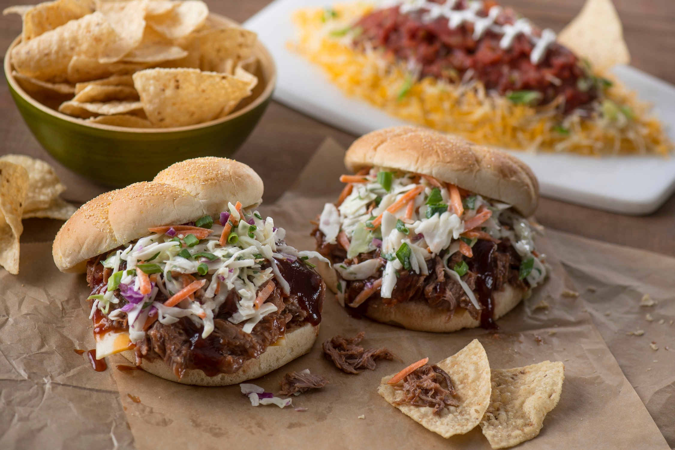 Slow Cooker Recipes for Easy Tailgating - We love a good slower cooker! All you need to do is throw some stuff in it, and a few hours later you have deliciousness (just make sure your fire alarm has batteries). You'll be able to feed your team without missing a play.