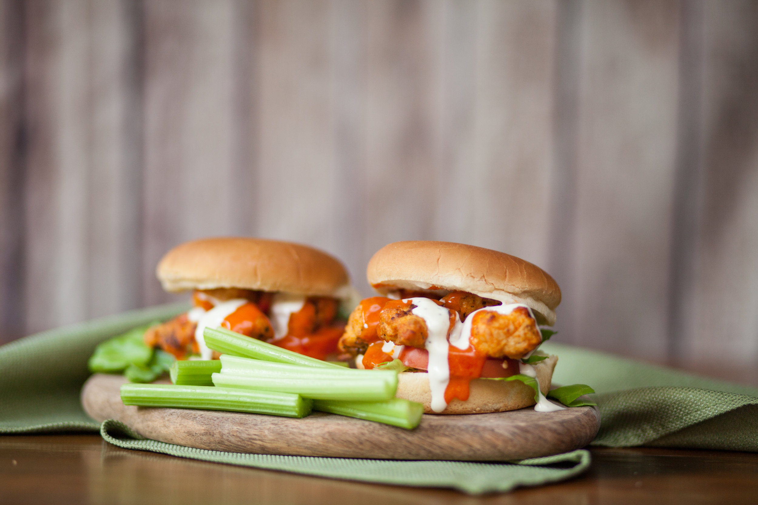 4. Buffalo Chicken Sandwiches - Buffalo chicken wings are a sports bar staple, but a tad messy out in the lot. Piling slow cooked shredded buffalo chicken on a Johnsonville Honey Bun allows you to ditch the wet wipes and get back to the pre-game festivities.