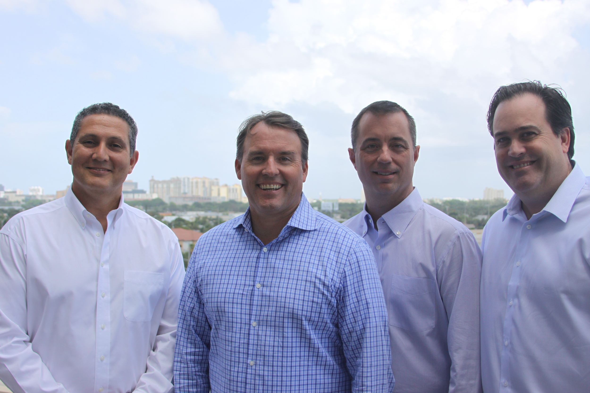 Finova Financial executives (left to right): Juan Ramirez, CEO Gregory Keough, Derek Acree, and Alfredo Rosing.      PHOTO: FIN    OVA
