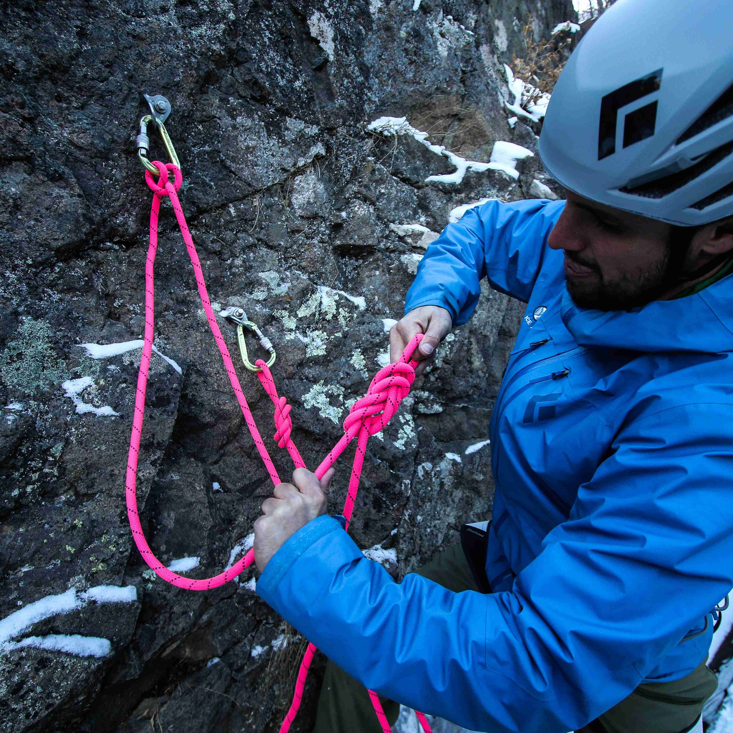 9. With the working end of the rope a few feet away from the clove hitch, tie a figure-8 on a bight and clip it into the same locking carabiner to close the system. -