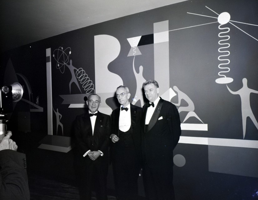 Dr. Brian O'Brien of American Optical (center) poses with Richard Rodgers (left) and Oscar Hammerstein (right), composers of Oklahoma!, at the New York premiere (1955)