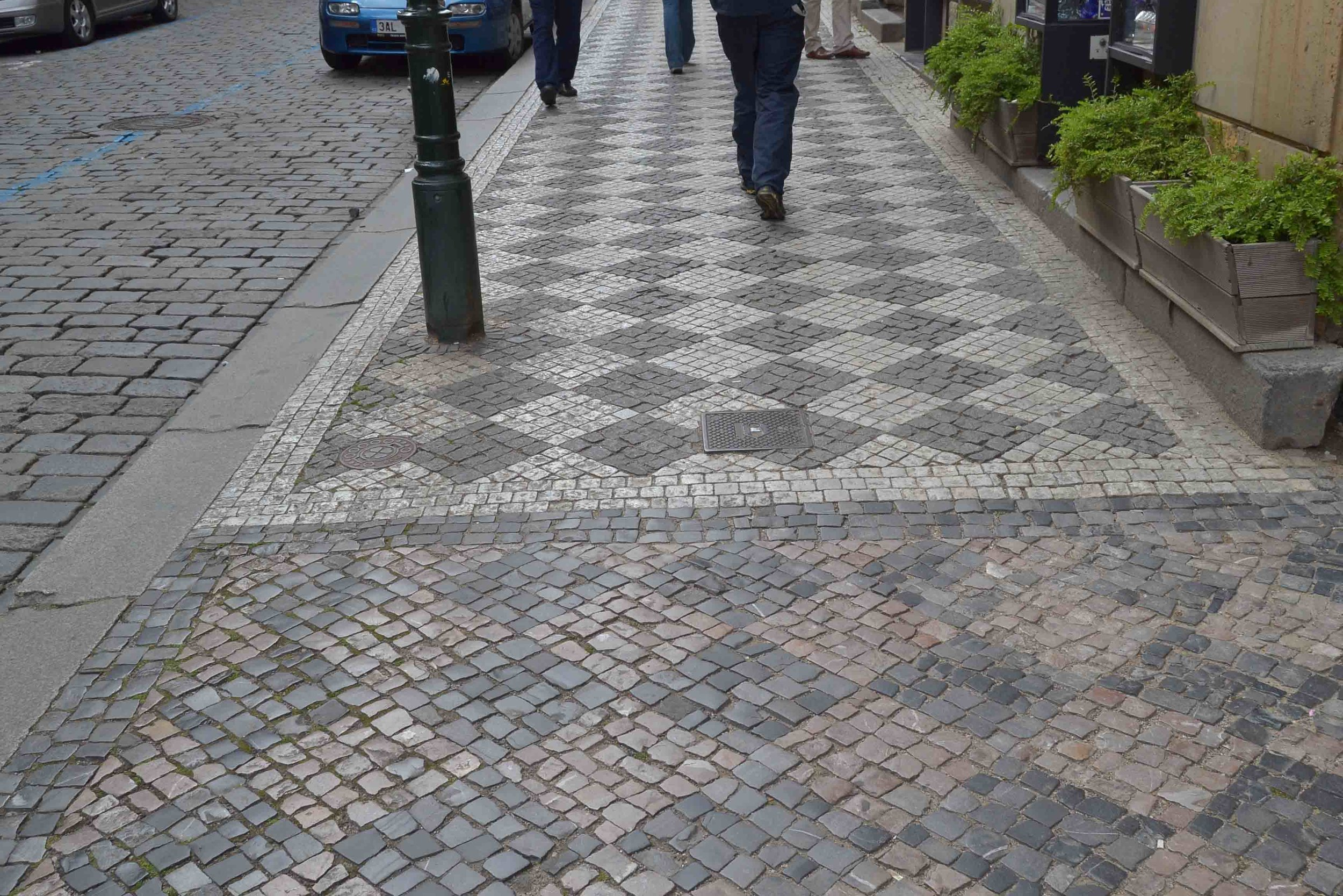 Variety of colours and textures in the sidewalk paving in Prague
