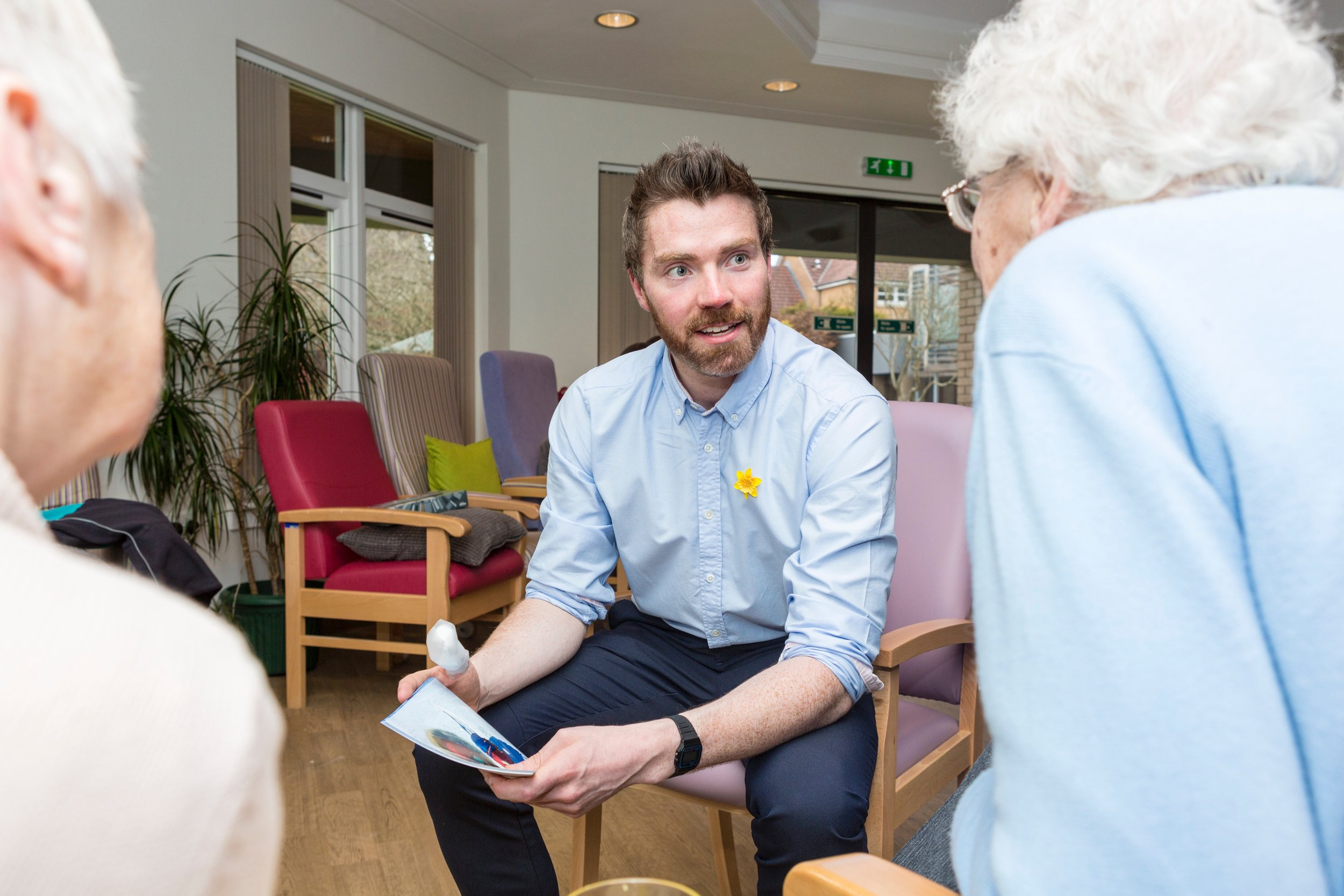 Luke telling stories about his Antarctic expedition at the Marie Curie Hospice, Edinburgh