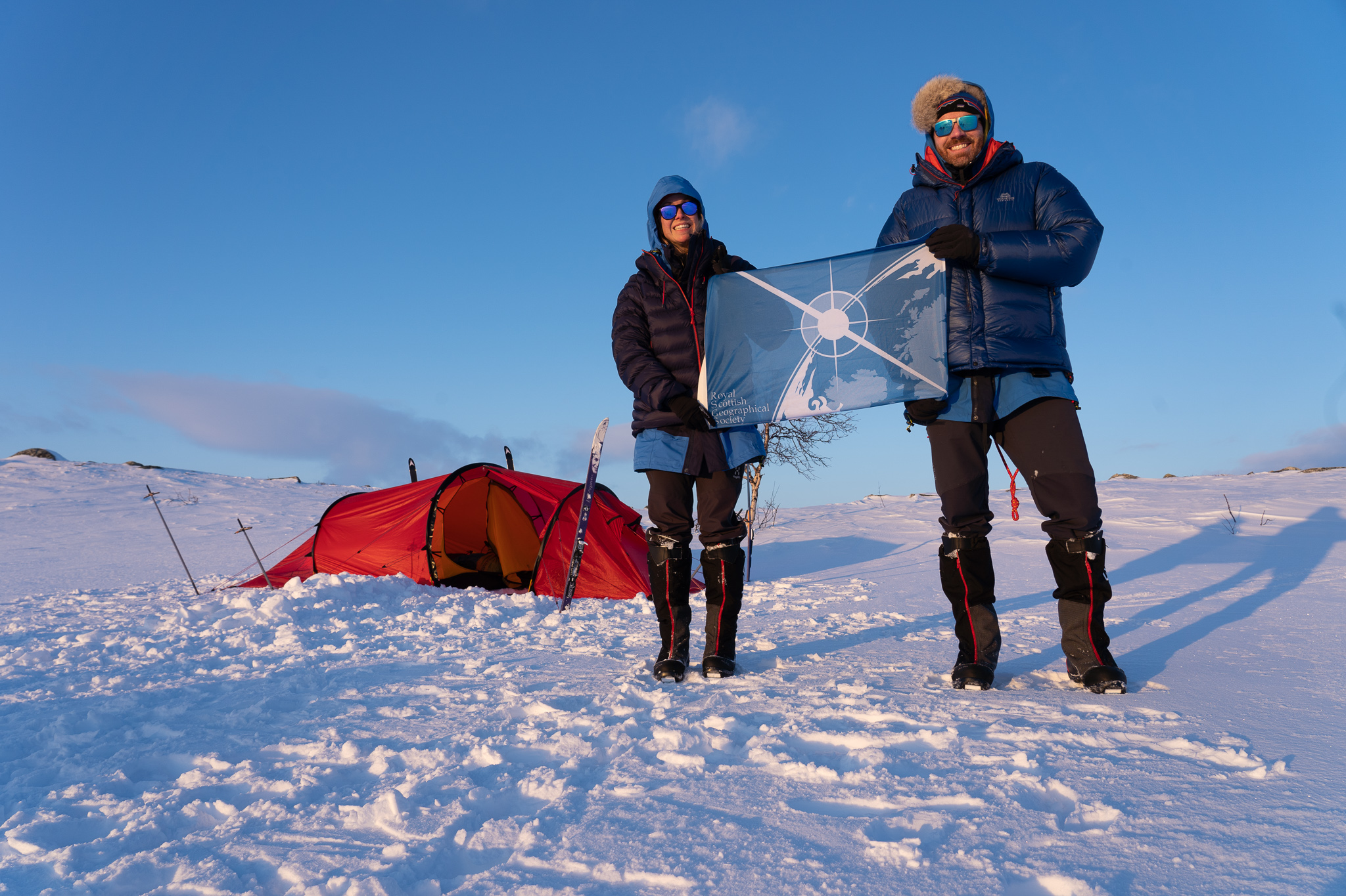 Hazel and Luke with the RSGS flag on Finnmarksvidda