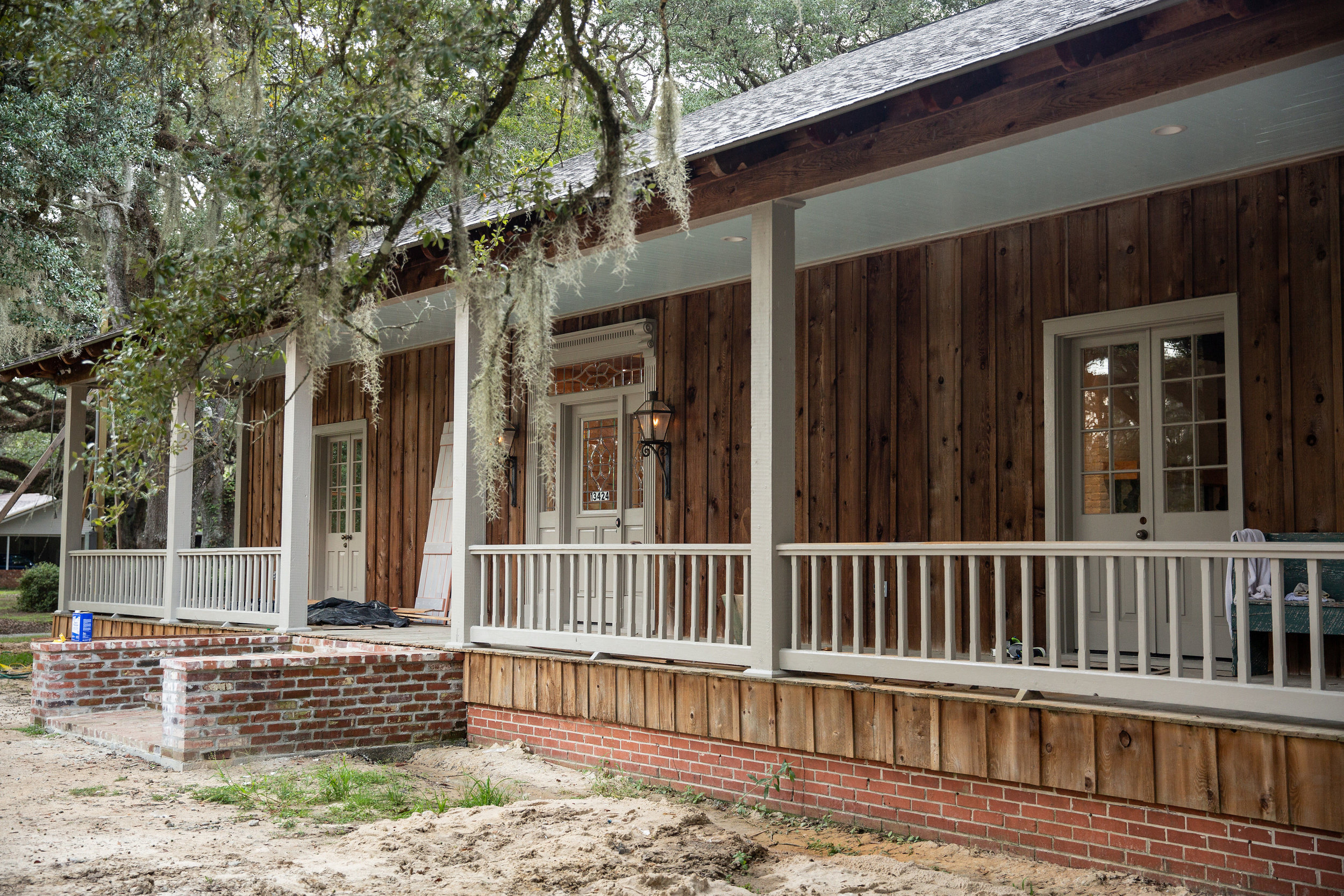 A wide front porch complete with original gas lamps welcomes visitors to sit a spell—to enjoy the fall weather to come.