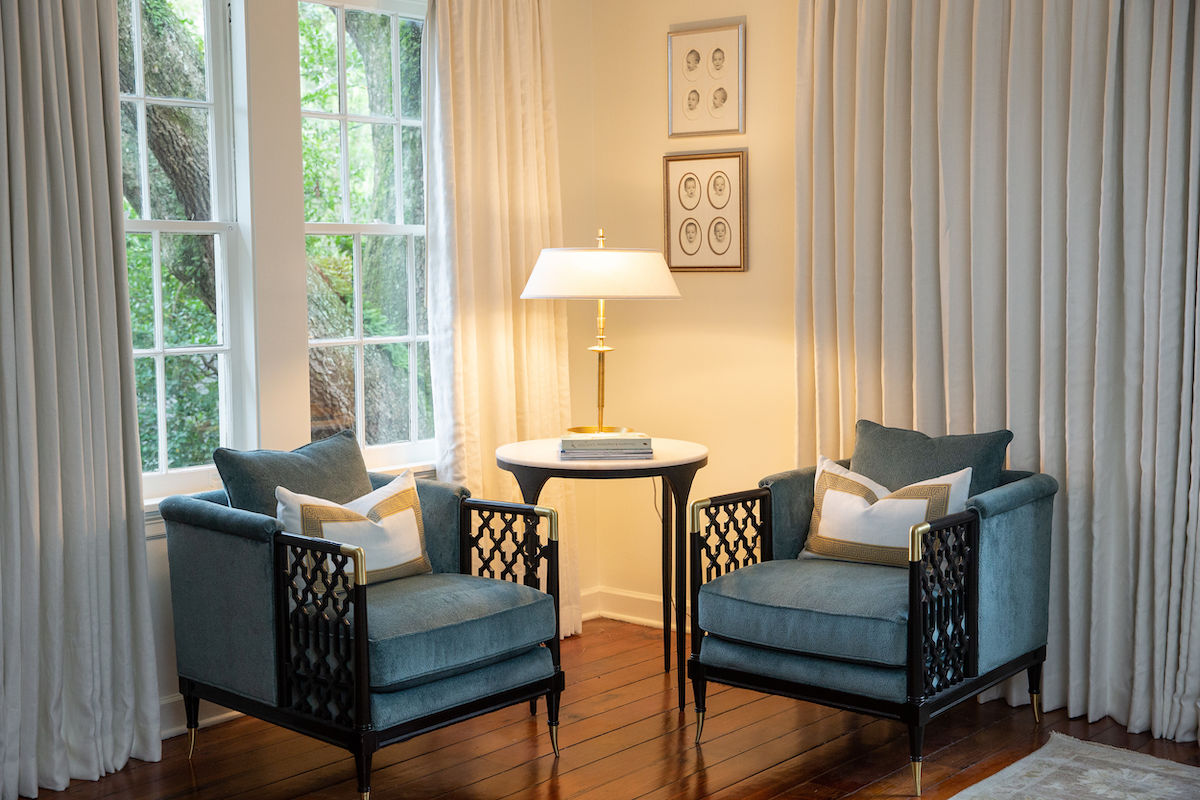 Look how much custom draperies warm up this master suite seating area. Floor to ceiling draperies make a big impact!