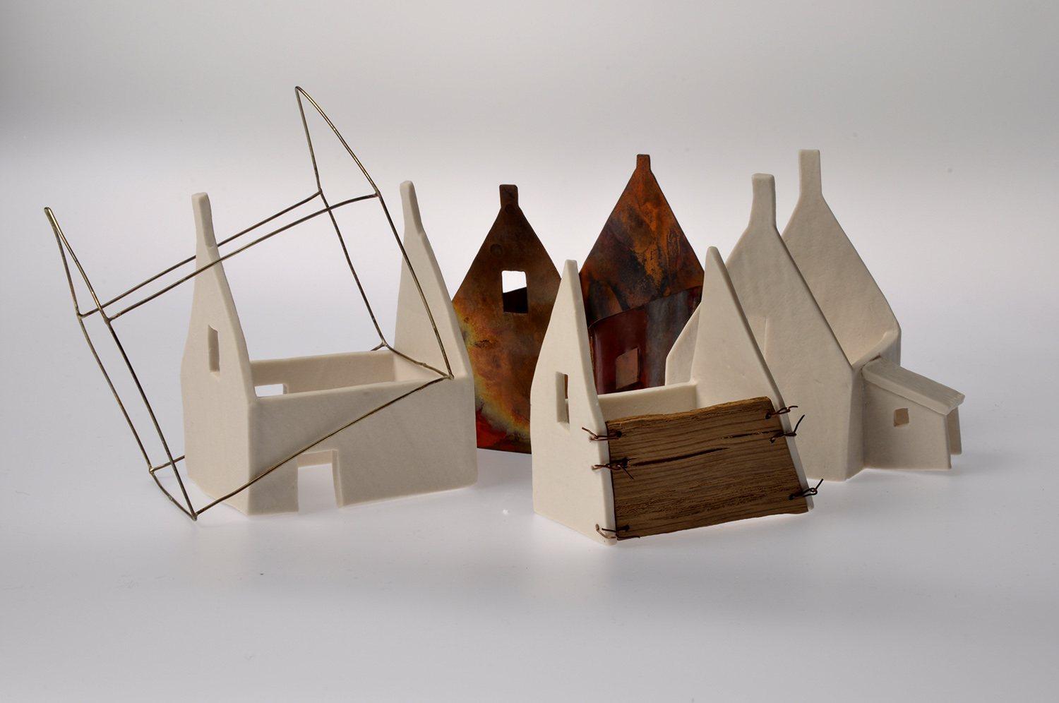 Porcelain, copper, brass and oak. Sizes vary. Approx. 6cm x 7cm x 8cm