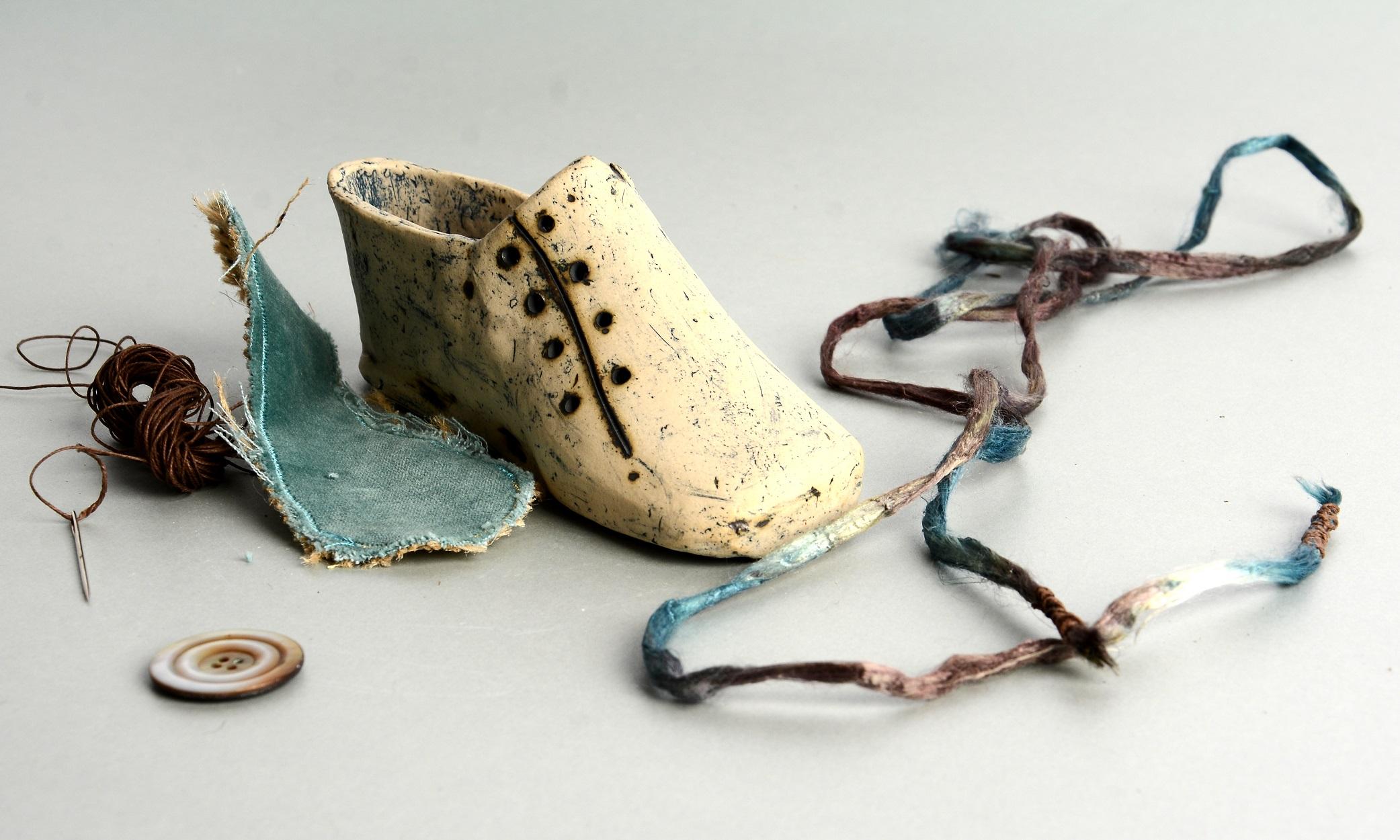 Ceramic, hessian, velvet, silk cord, nettle yarn, found objects. Approx. 15cm x 6 cm x 8cm