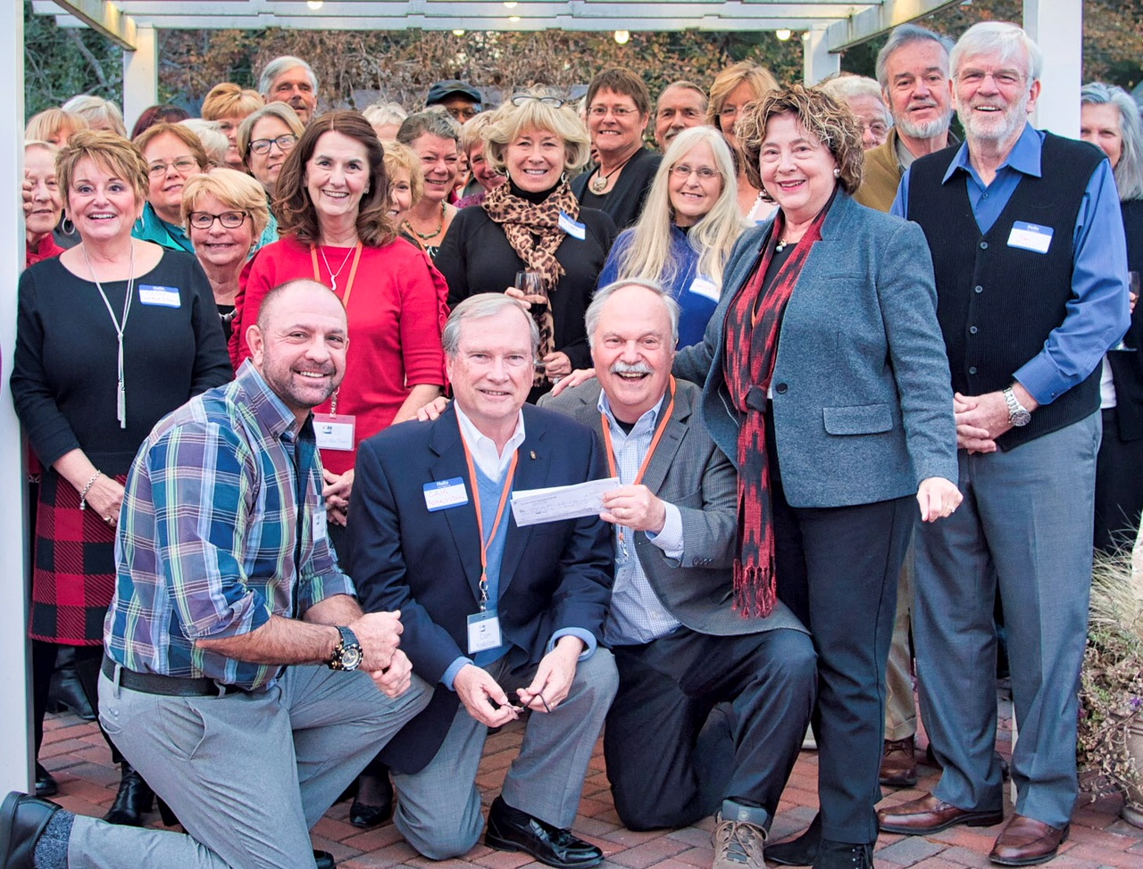 Many of our volunteers at the 2017 Delaware Botanic Gardens Volunteer Appreciation dinner stand behind Gregg Tepper, Cam Yorkston, Ray Sander and Sheryl Swed who are displaying the grant check from the Ellice & Rosa McDonald Foundation.