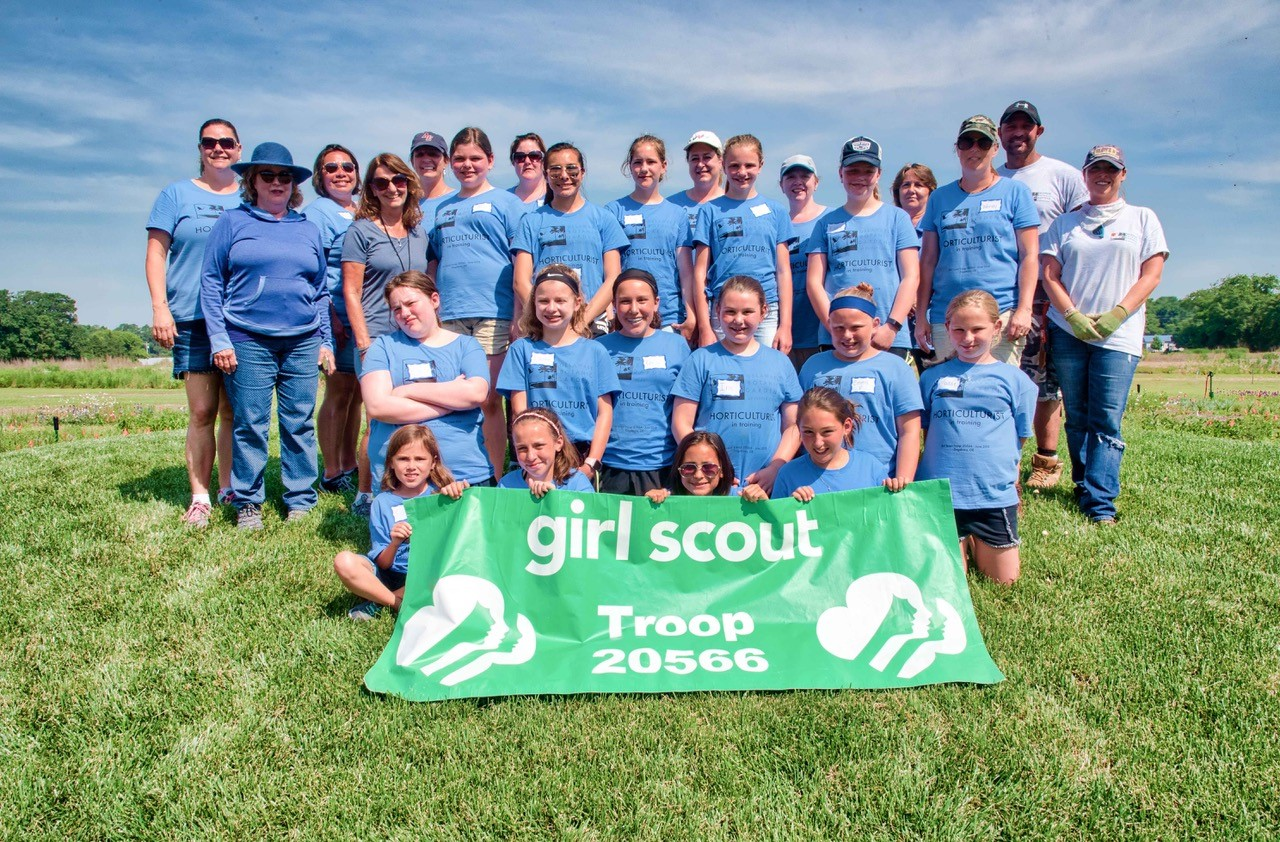 Troop 20566 & adult leaders Marie Moore & Wendy Brister on  Mound in Meadow Garden with dbg hosts sheryl swed, left & gregg tepper, right photo by ray bojarski