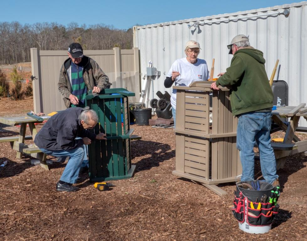 Ron Bass, George Robbins, x and y assembling benches.jpg