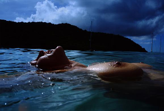 Nan Goldin,  Valerie Floating in the Sea,  Mayreaux Island,  2002                                            Nan Goldin                                                                   wish you were here  Curated by Carrie Mackin, 2013