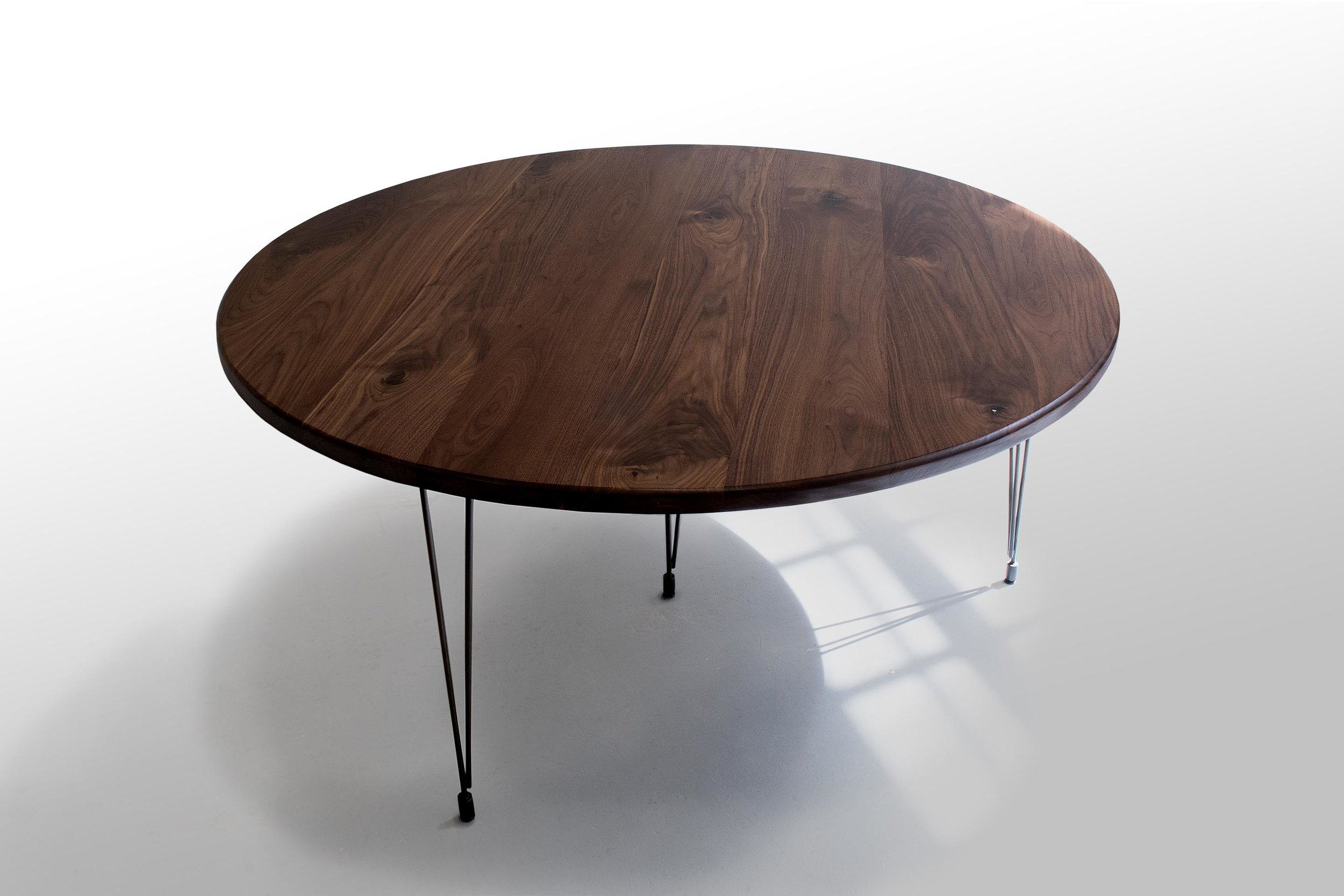 62 inch round walnut table.jpg