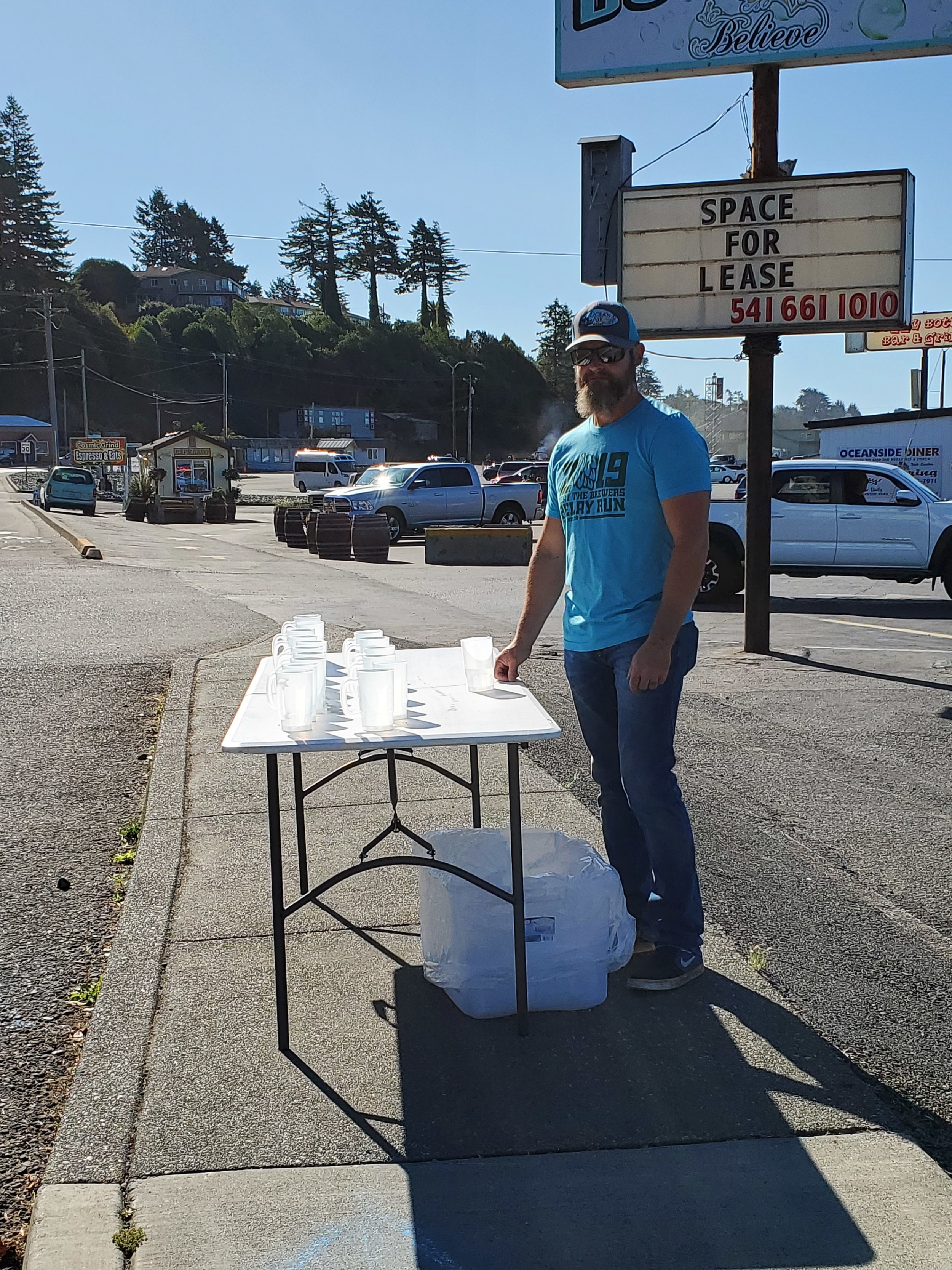 Tom volunteering at the mug station
