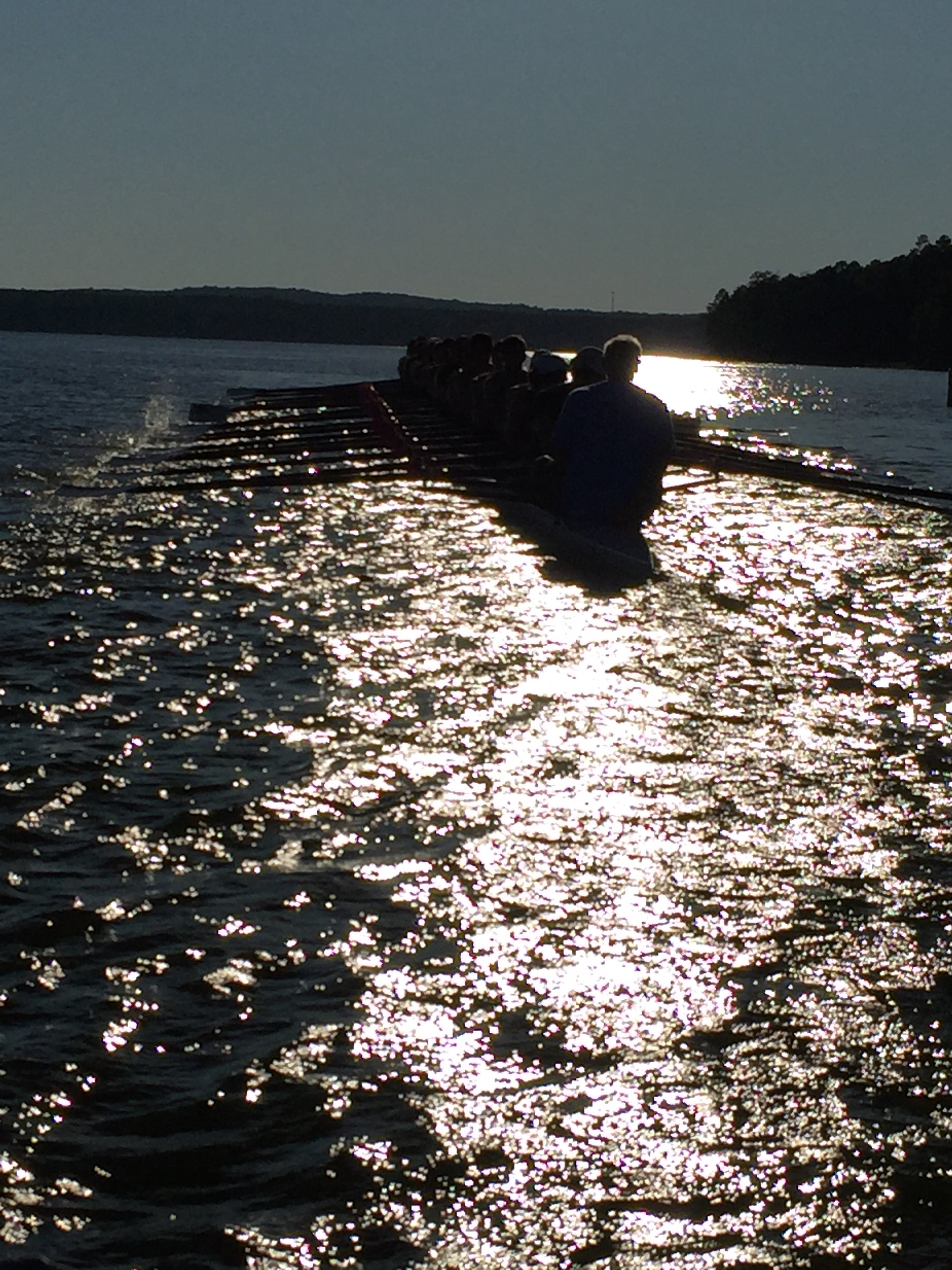 UNC Students row into the sunset - coxed by Melchior Buergin