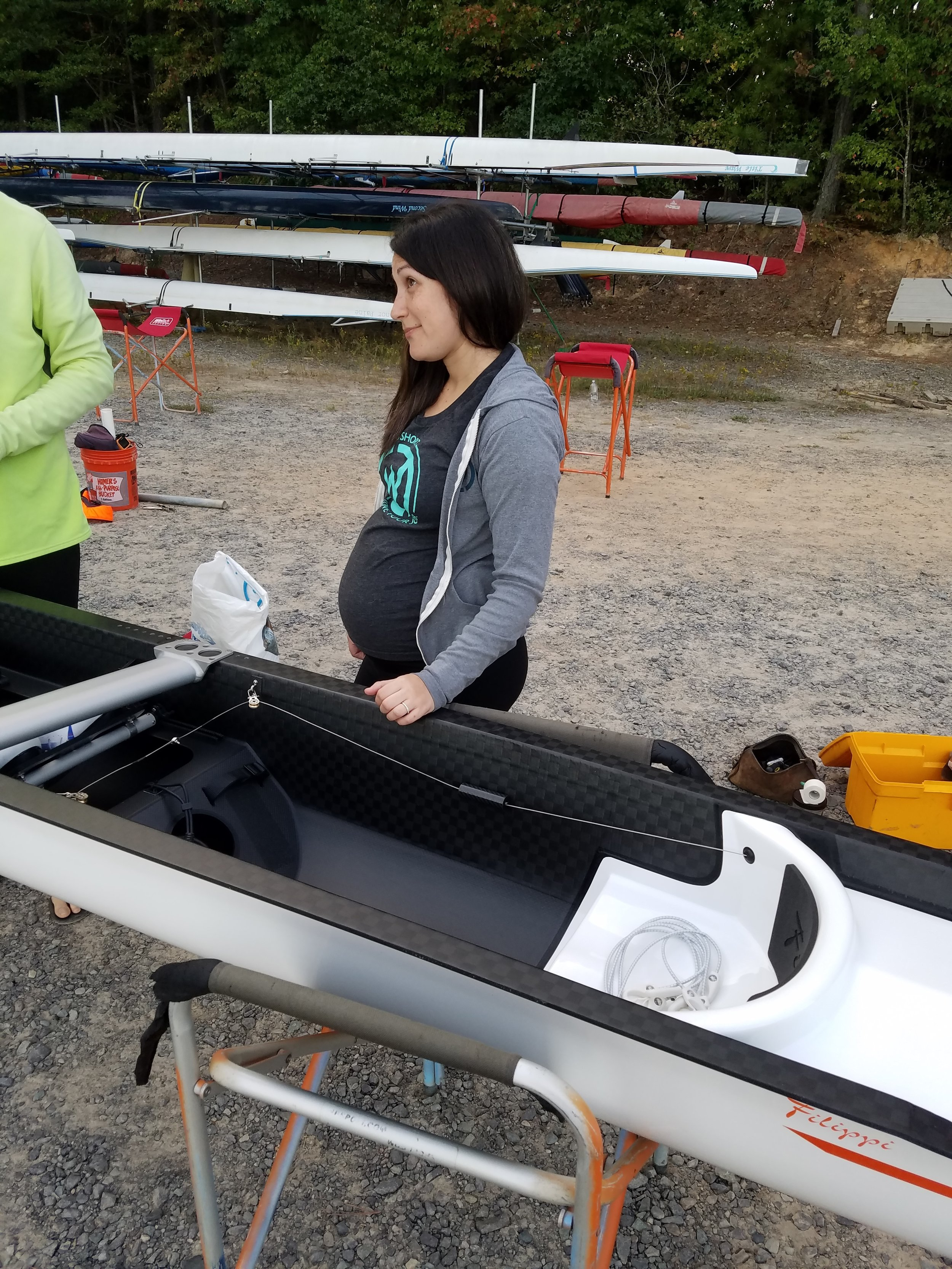 Our cox Kylie with the future son inspecting the coxswain seat in our brand new Filippi 4+
