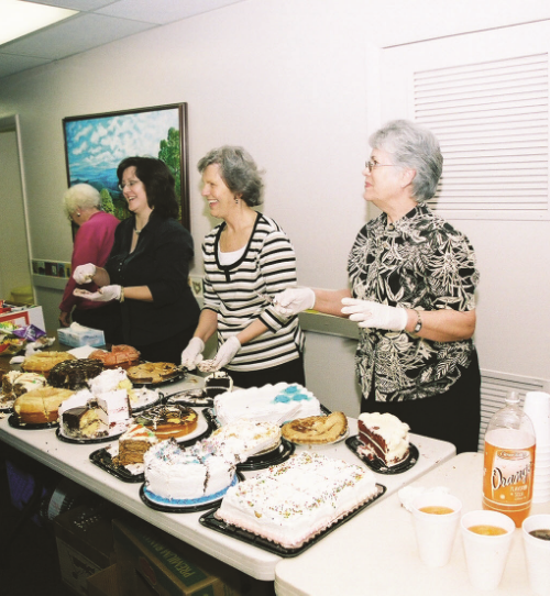 Volunteers serving refreshments after the service