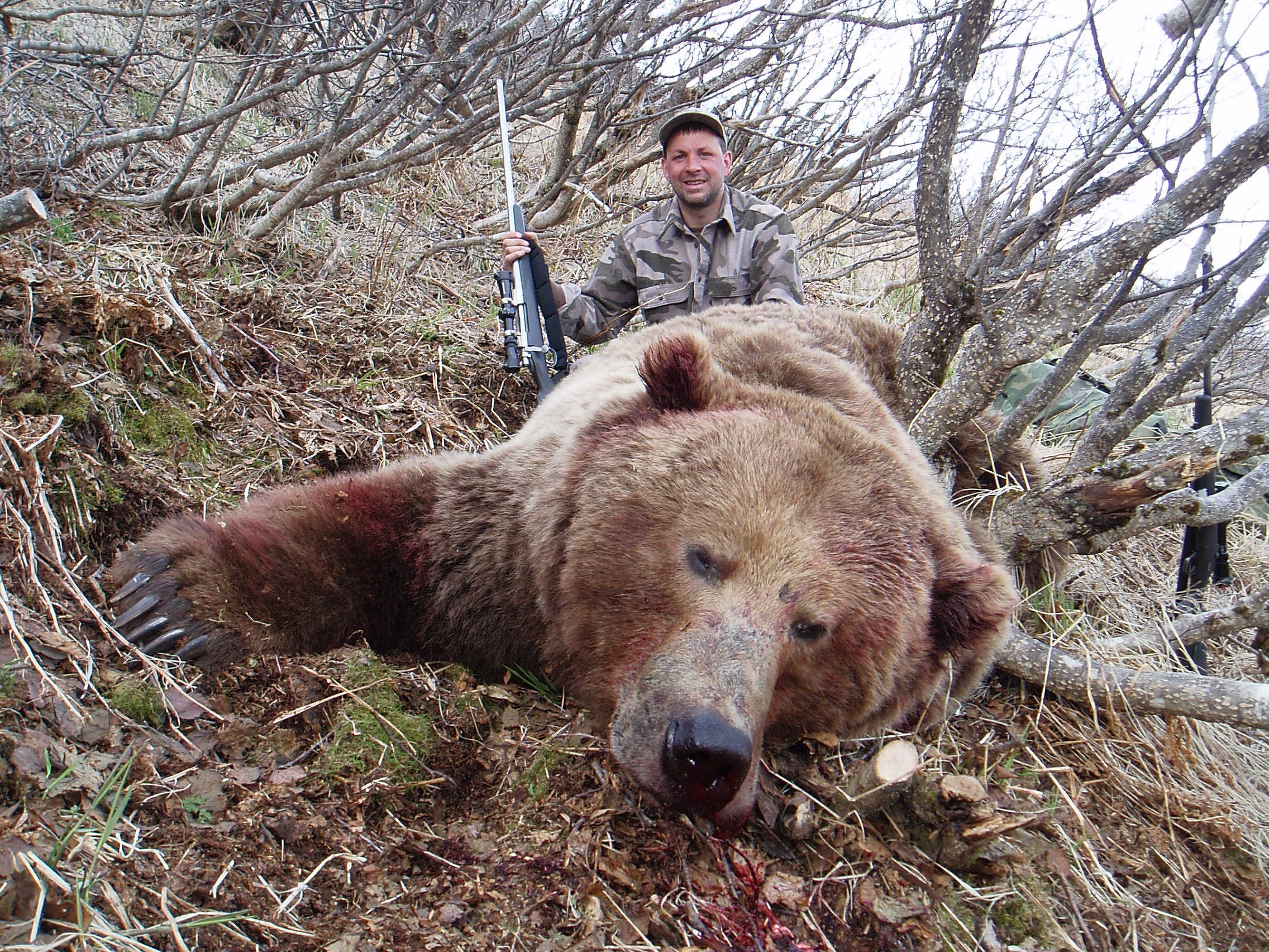 """My son-in-law, Sagen Juliussen, with his 10'1"""" brown bear."""