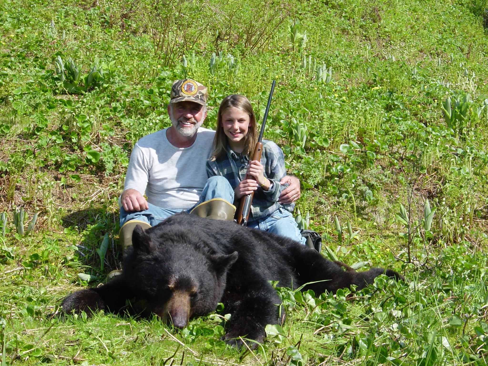 "Granddaughter Jordan and me with her 6'8"" black bear."