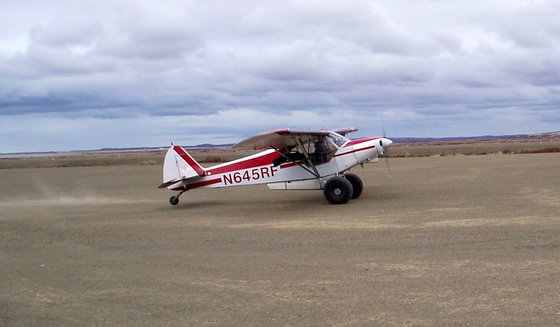 Gary Bishop, Chief Pilot for AAA Alaskan Outfitters in Pilot Point, AK picking up clients