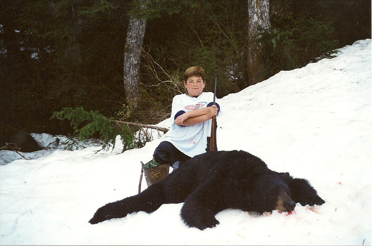 "Greg Rapp at the age of 11 was my first grandchild to harvest a black bear.  His is the largest to date.  It squared 7'1"" and had a 19 3/16"" skull."
