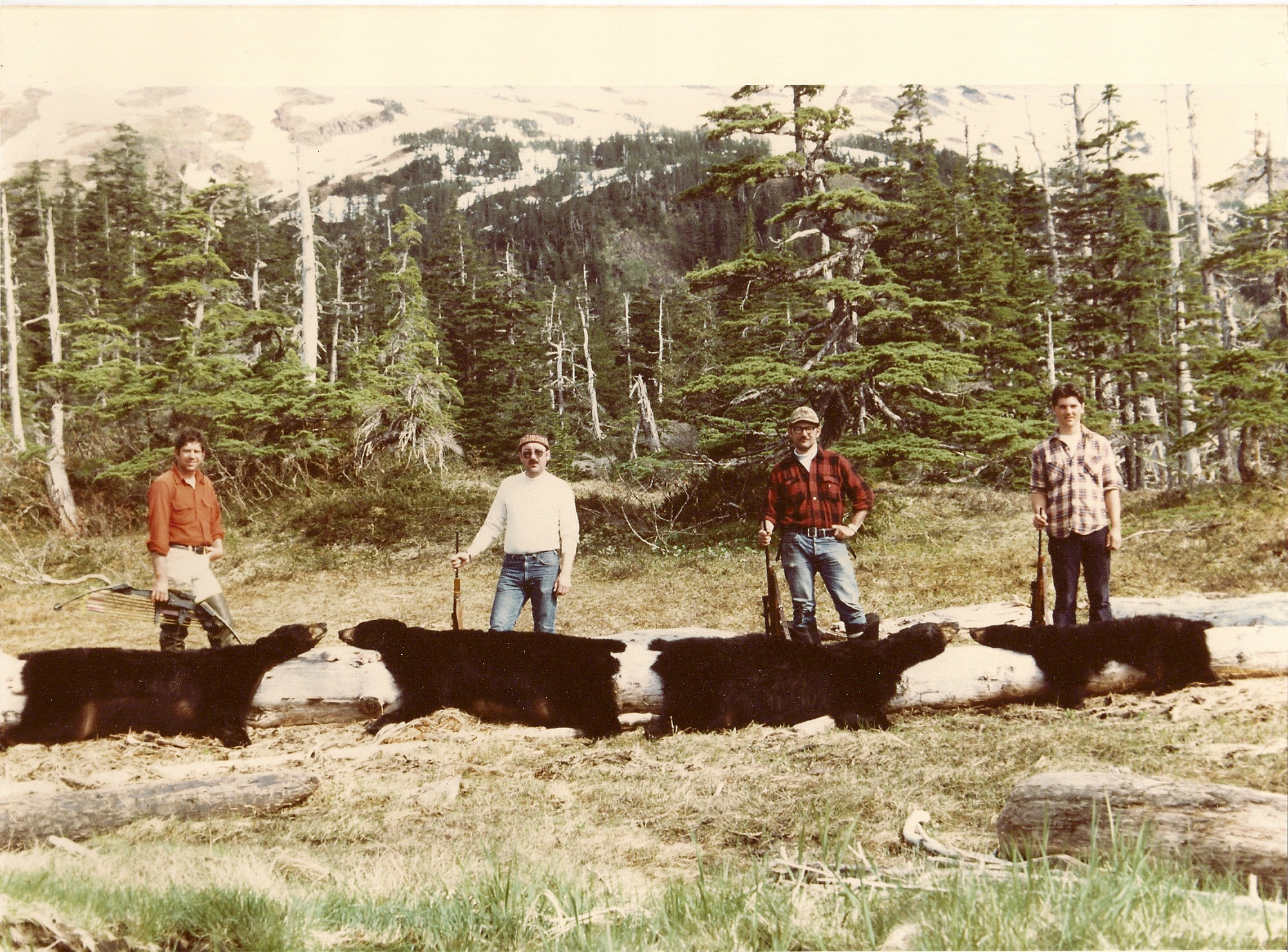 This was the second year that we harvested 4 bears in a weekend.  Two of these bears were tagged with radio collars.  From (L to R) myself, Earl Boucher, Dan Schwarzer (later became my partner in the guide business) and Scottie Bailey.