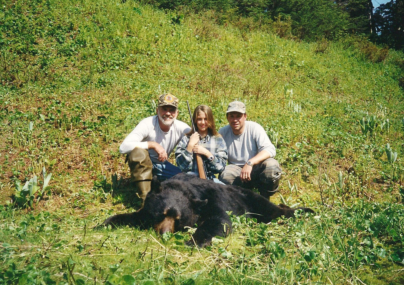 "Jordan, her dad and myself with her beautiful 6'8"" black bear."