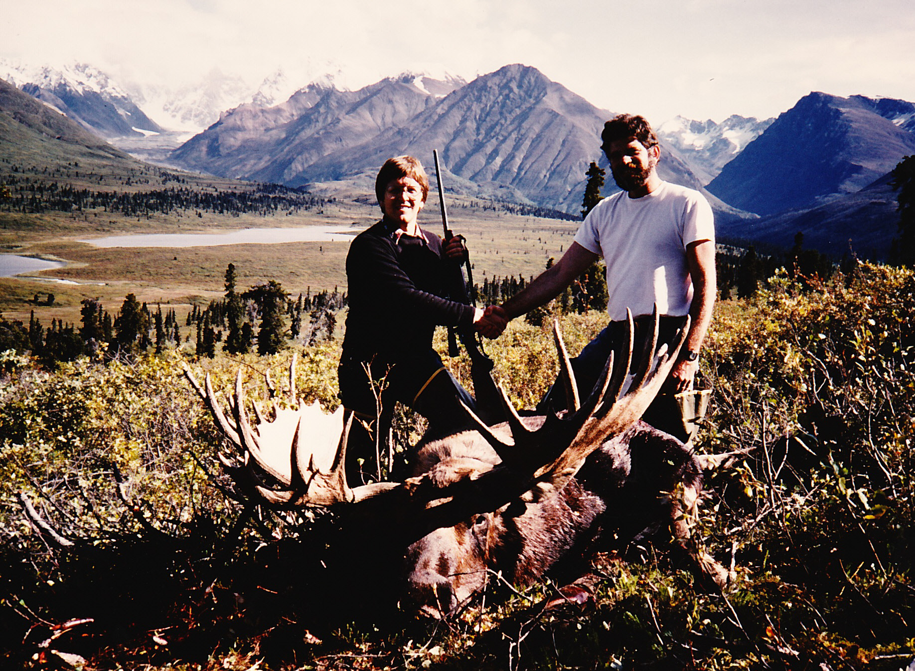 "Bryan Kettel and me with his beautiful 62 1/2"" moose.  Big Bend Lakes and the beautiful landscape of the Wrangell Mountains.  This was AAA's first moose."